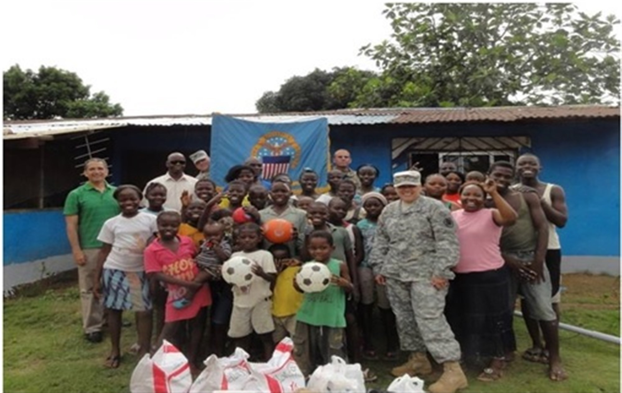 Defense Logistics Agency (DLA) Europe-Africa Commander, COL Deborah Keough, brings toys and supplies to orphanage in Liberia. Deliberate planning and actions across the entire logistics enterprise united the efforts of a multi-disciplined, interagency team formed across nations, governments and non-government organizations (NGOs) which directly led to success in OPERATION United Assistance. U.S. AFRICOM photo/released)