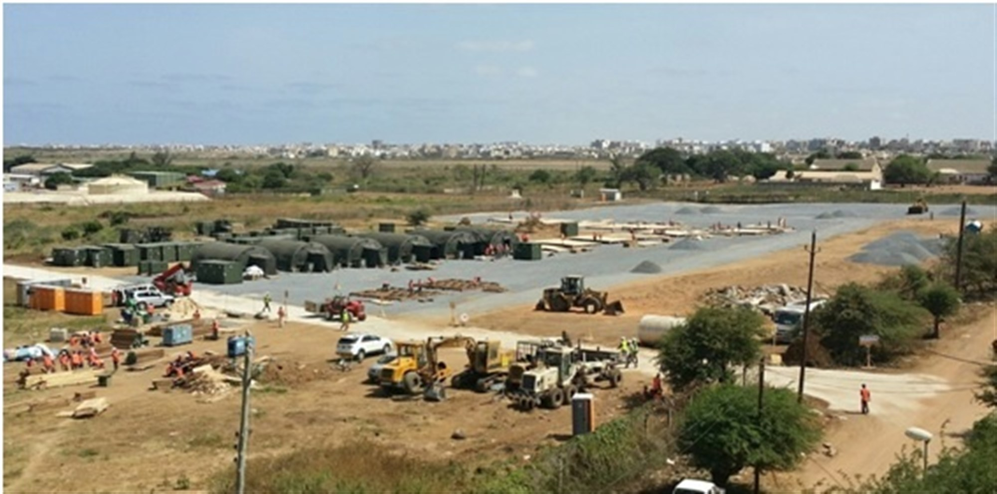 Construction of Initial Staging Base (ISB), Dakar, Senegal. Deliberate planning and actions across the entire logistics enterprise united the efforts of a multi-disciplined, interagency team formed across nations, governments and non-government organizations (NGOs) which directly led to success in OPERATION United Assistance. (U.S. AFRICOM photo/released)