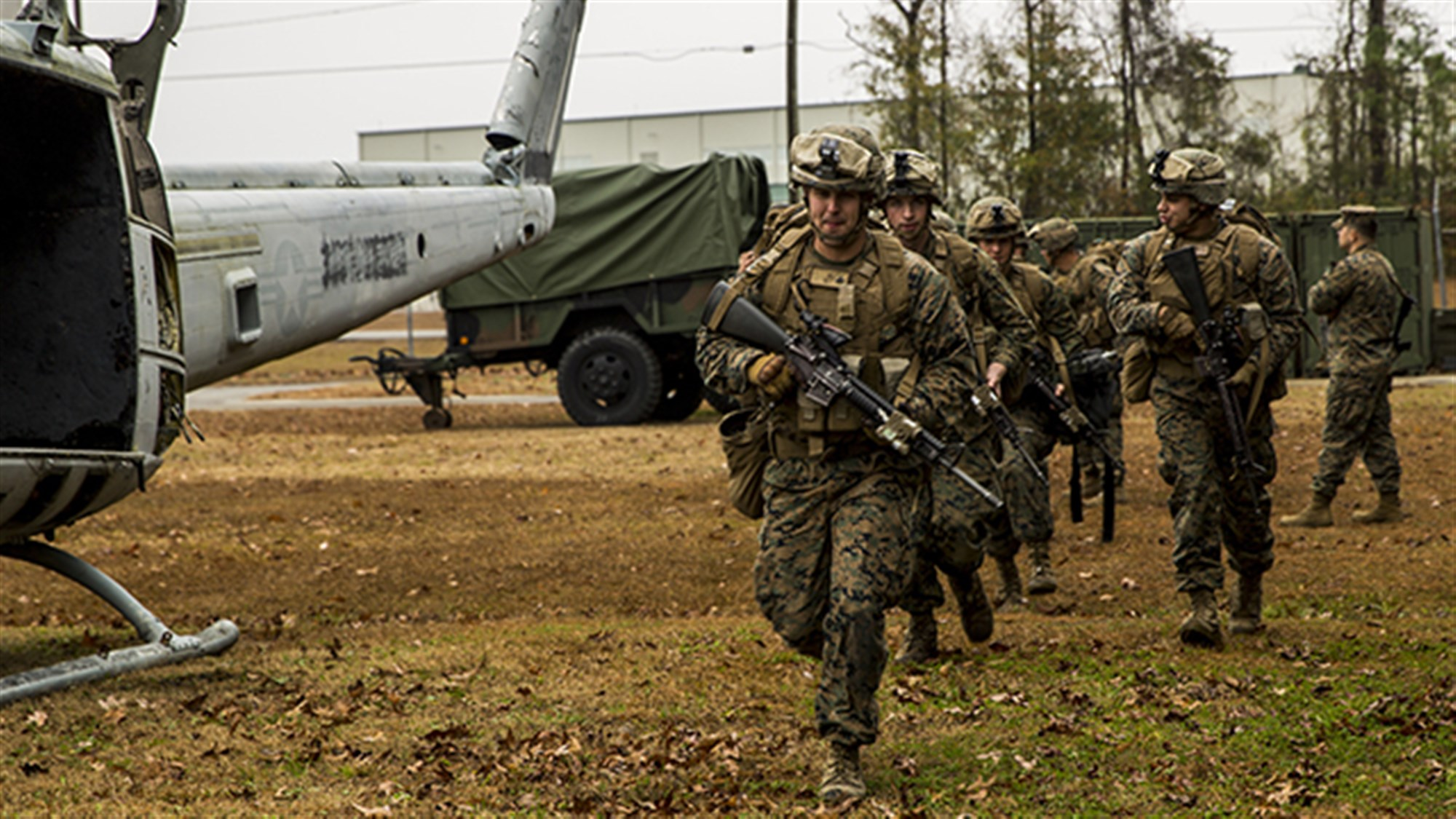 MARINE CORPS BASE CAMP LEJEUNE, North Carolina - Marines with 2nd Battalion, 8th Marine Regiment practice entering and exiting the MV-22B Osprey during a simulated Tactical Recovery of Aircraft and Personnel, or TRAP, mission aboard Marine Corps Air Station New River, Dec. 9, 2014. The TRAP training provides designated forces tactical training and initial evaluation in order to conduct search and personnel recovery operations for the upcoming deployment with Special-Purpose Marine Air-Ground Task Force Crisis Response-Africa. (Photo by U.S. Marine Lance Cpl. Krista James)