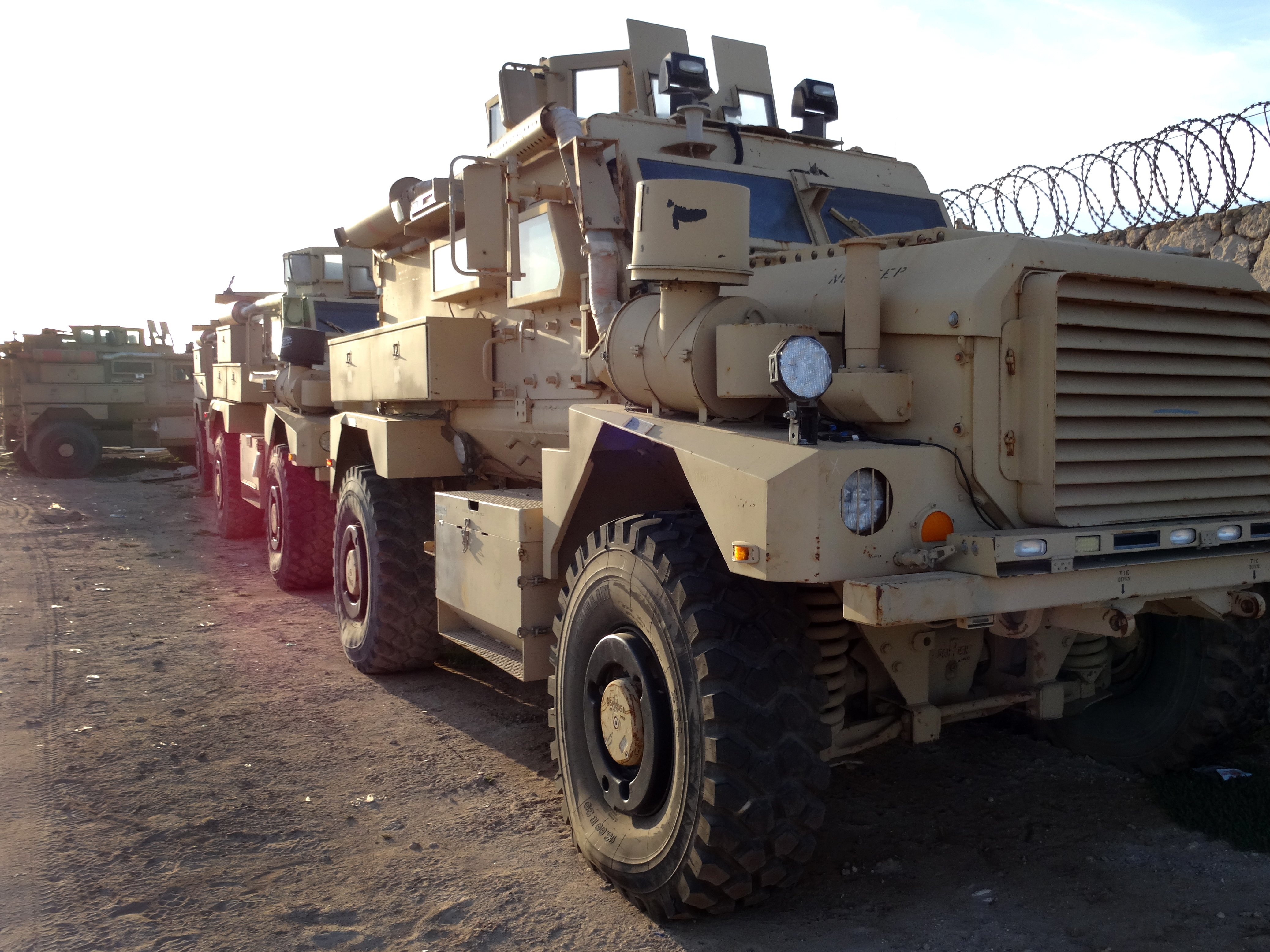 Four Mine-Resistant Ambushed Protective Vehicles that are part of the 20 vehicles that will be donated to Troop Contributing Countries Uganda and Burundi, wait to be turned over at the end of the month, Jan 13, 2014. (U.S. Army Courtesy Photo)