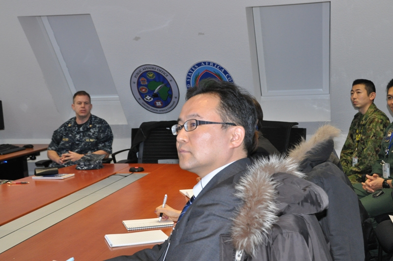 A team of Japanese Public Affairs Officers (PAOs) gets a tour of the command's public affairs office during a visit to U.S. Africa Command's headquarters in Stuttgart, Germany, Jan. 23, 2015.