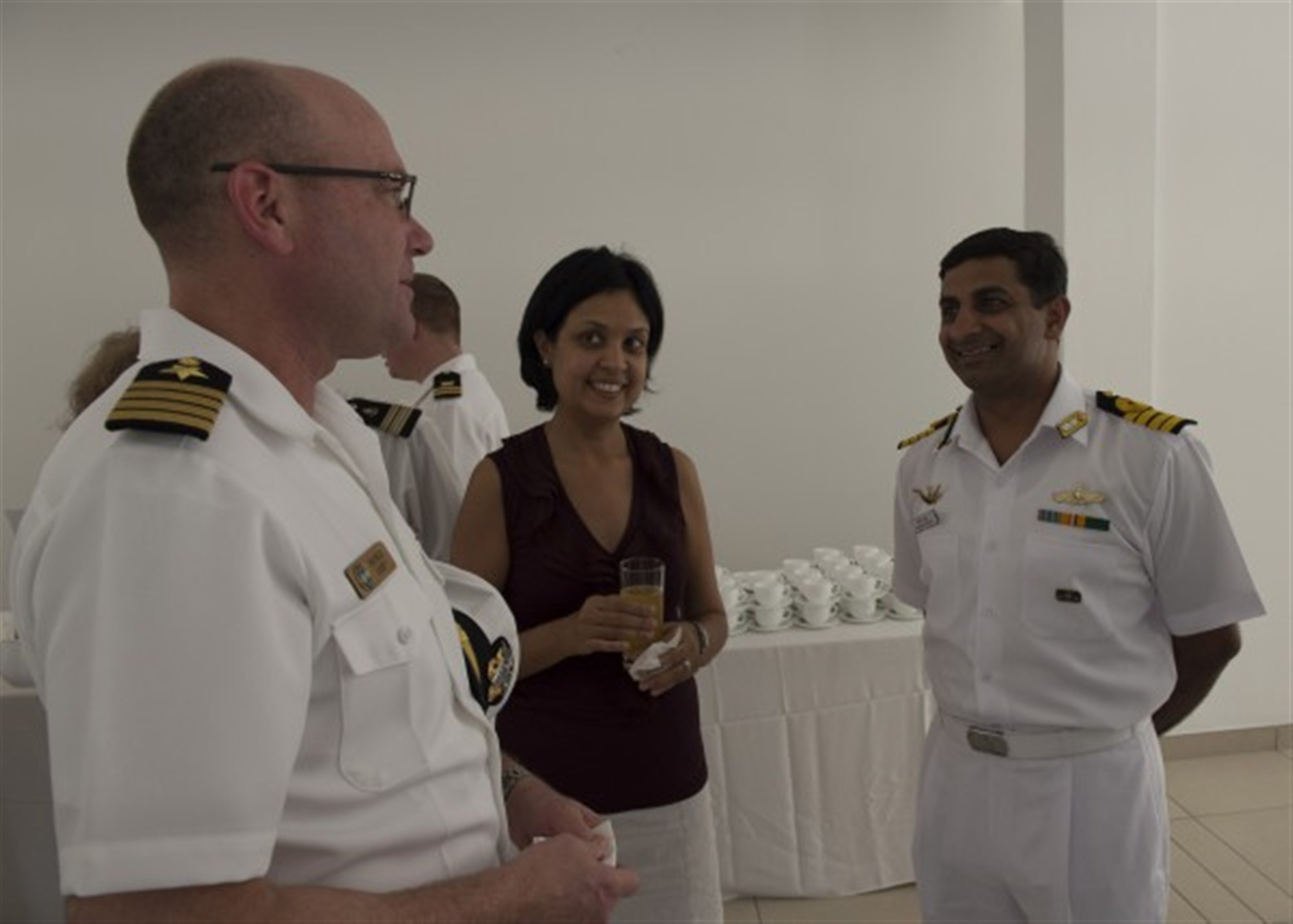 LE CHALAND, Mauritius (Jan. 28, 2015) U.S. Navy Capt. Patrick Carey, exercise director of Exercise Cutlass Express 2015, interacts with other attendees after the opening ceremony of the annual exercise Jan. 28, 2015. Exercise Cutlass Express 2015, sponsored by U.S. Africa Command, is designed to improve regional cooperation, maritime domain awareness, and information sharing practices to increase capabilities of East African and Indian Ocean nations to counter sea-based illicit activity. (U.S. Navy photo by Mass Communication Specialist 1st Class David R. Krigbaum/Released)