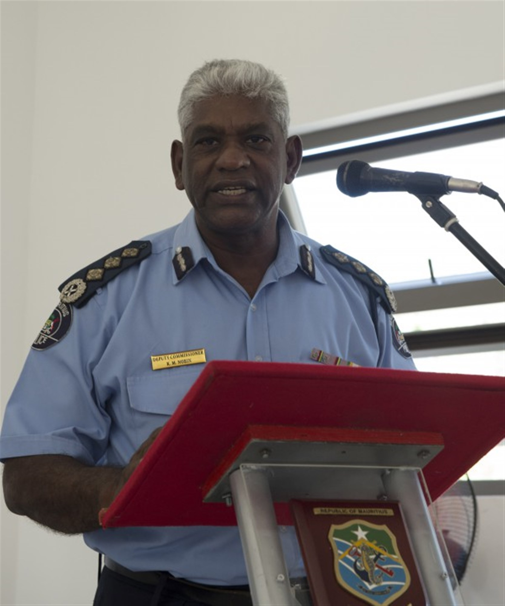 LE CHALAND, Mauritius (Jan. 28, 2015) Mauritian Deputy Commissioner of Police Mario Nobin addresses attendees during the opening ceremony of Exercise Cutlass Express 2015, Jan. 28. Exercise Cutlass Express 2015, sponsored by U.S. Africa Command, is designed to improve regional cooperation, maritime domain awareness, and information sharing practices to increase capabilities of East African and Indian Ocean nations to counter sea-based illicit activity. (U.S. Navy photo by Mass Communication Specialist 1st Class David R. Krigbaum/Released)