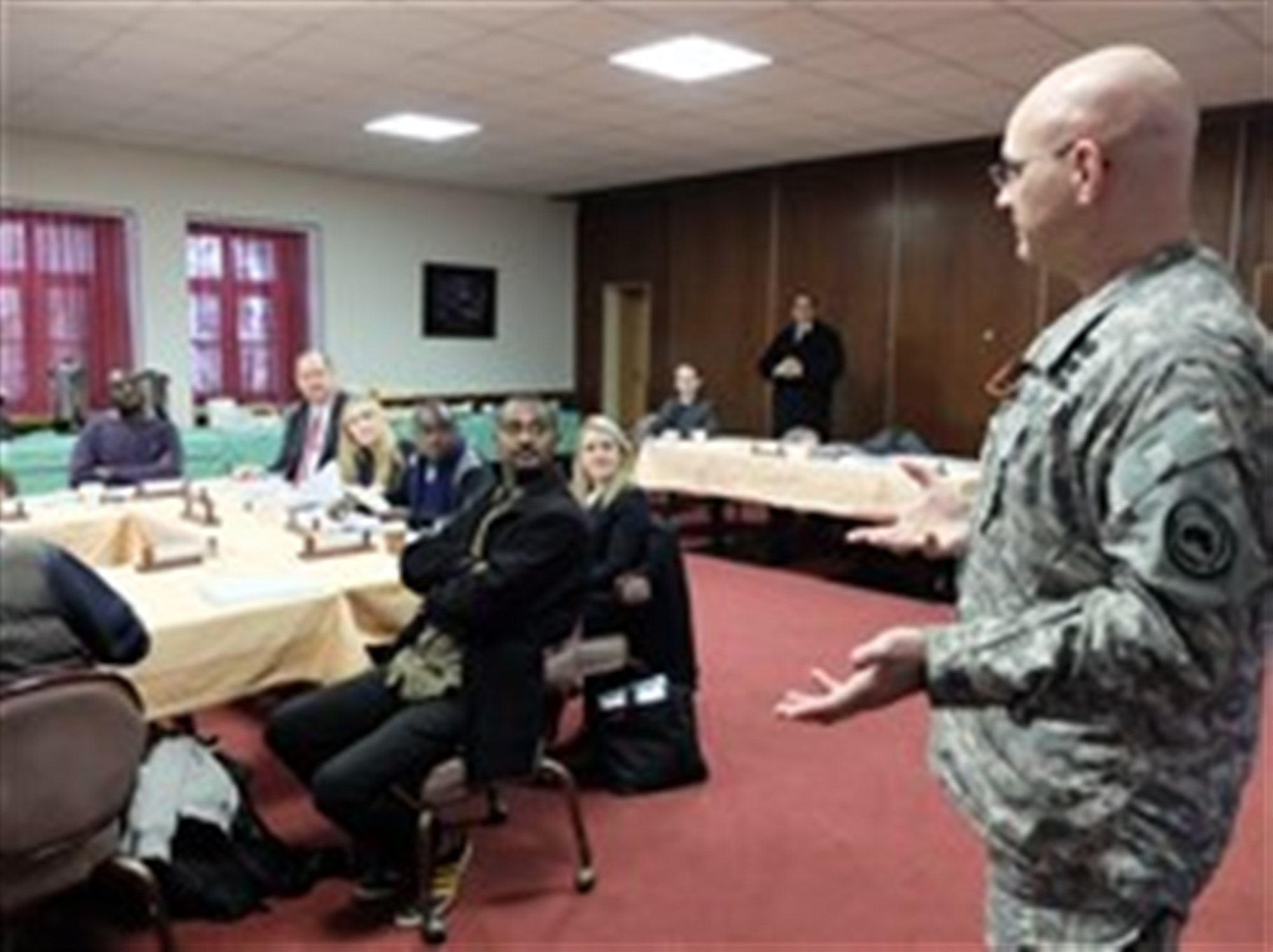 COL Mark Cheadle, AFRICOM's Chief of Public Affairs and Communication Synchronization, engages African journalists during a media delegation visit, Feb. 9, 2015, at Kelley Barracks, U.S. Army Garrison, Stuttgart, Germany.  Eight journalists, who are accredited with the African Union, are here as participants of a U.S. AFRICOM-sponsored media delegation visit to learn about the command's mission and programs. (Photo by Brenda Law/U.S. Africa Command Public Affairs/Released)