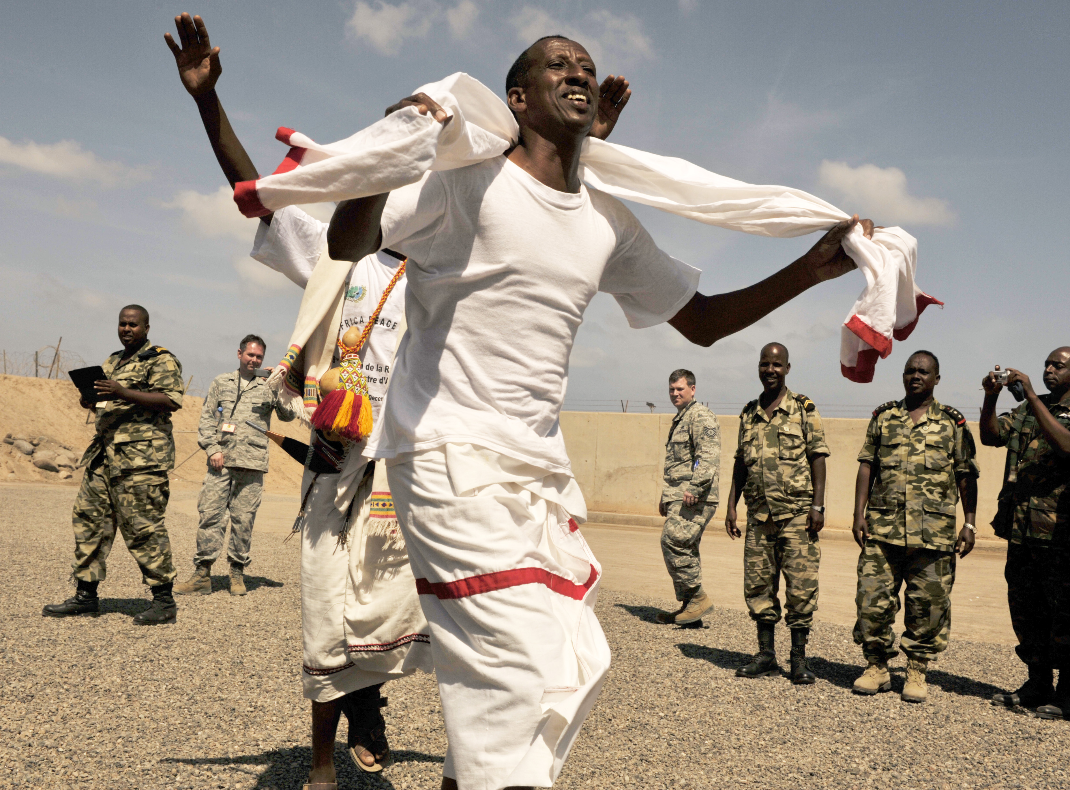 A Djiboutian air force member performs a traditional dance as part of a cultural exchange during African Partnership Flight–Djibouti at Djibouti Air Base, Feb. 9, 2015.  APF is the premiere program to bring together partner nations to increase cooperation and interoperability, which fosters stability and security throughout the continent. (U.S. Air Force Photo by Tech. Sgt. Ian Dean)