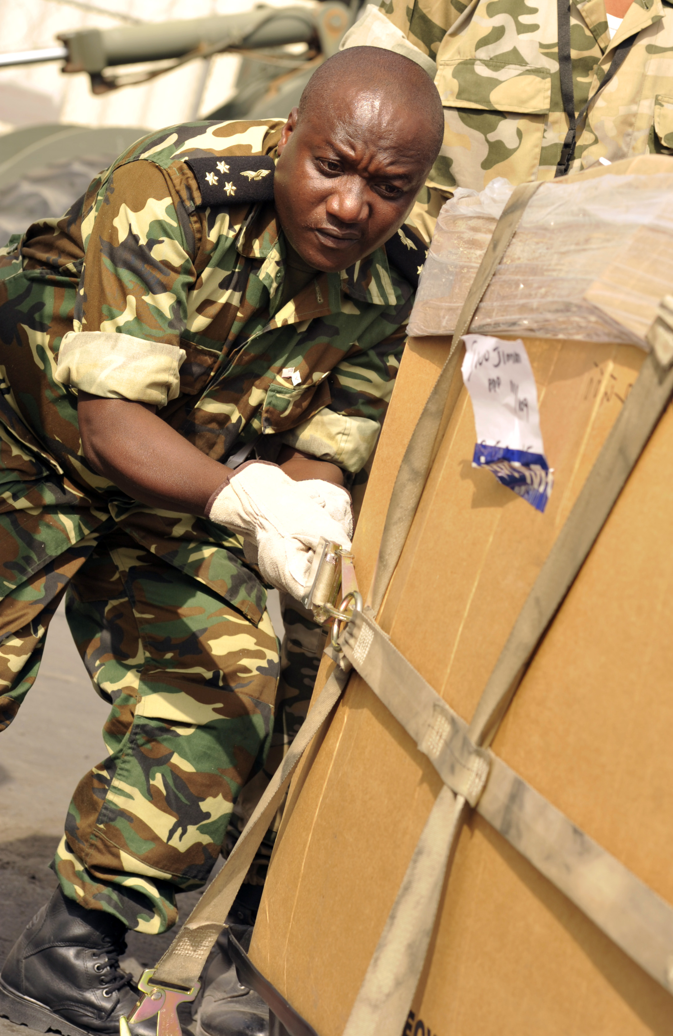 A Burundi air force captain tightens a cargo net as part of an aircraft cargo knowledge exchange during African Partnership Flight–Djibouti at Djibouti Air Base, Feb. 10, 2015.  APF is the premiere program to bring together partner nations to increase cooperation and interoperability, which fosters stability and security throughout the continent. (U.S. Air Force Photo by Tech. Sgt. Ian Dean)