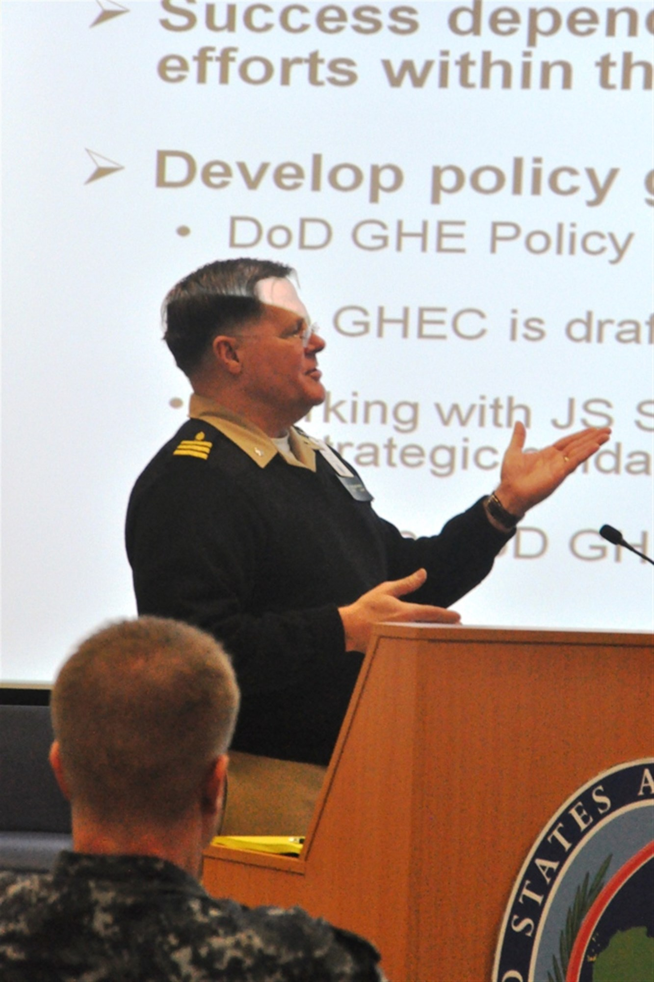 CDR Richard Gustafson, Office of the Undersecretary of Defense for Policy, briefs on DoD Global Health Engagement during the 2015 AFRICOM Partners Health Engagement Forum, a three-day event conducted at the U.S. Army Garrison Stuttgart, Germany at Kelley Barracks, Feb. 18-20, 2015.  The event was organized by the AFRICOM Command Surgeon's Office.  (U.S. Africa Command photo by Tech. Sgt. Olufemi A. Owolabi)