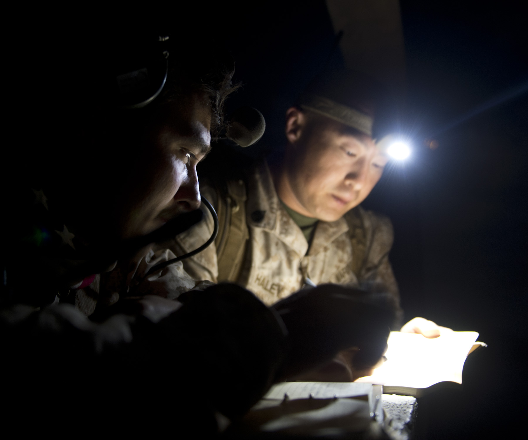 24th Marine Expeditionary Unit Joint Terminal Attack Control members read coordinates during a bilateral close air support training exercise in Arta, Djibouti, Feb. 4, 2015. The JTAC members work closely to communicate the best use of air power to provide CAS during military operations. The 24th MEU is embarked on the ships of the Iwo Jima Amphibious Ready Group and deployed to maintain regional security in the U.S. 5th Fleet area of operations. (U.S. Air Force photo by Staff Sgt. Kevin Iinuma)