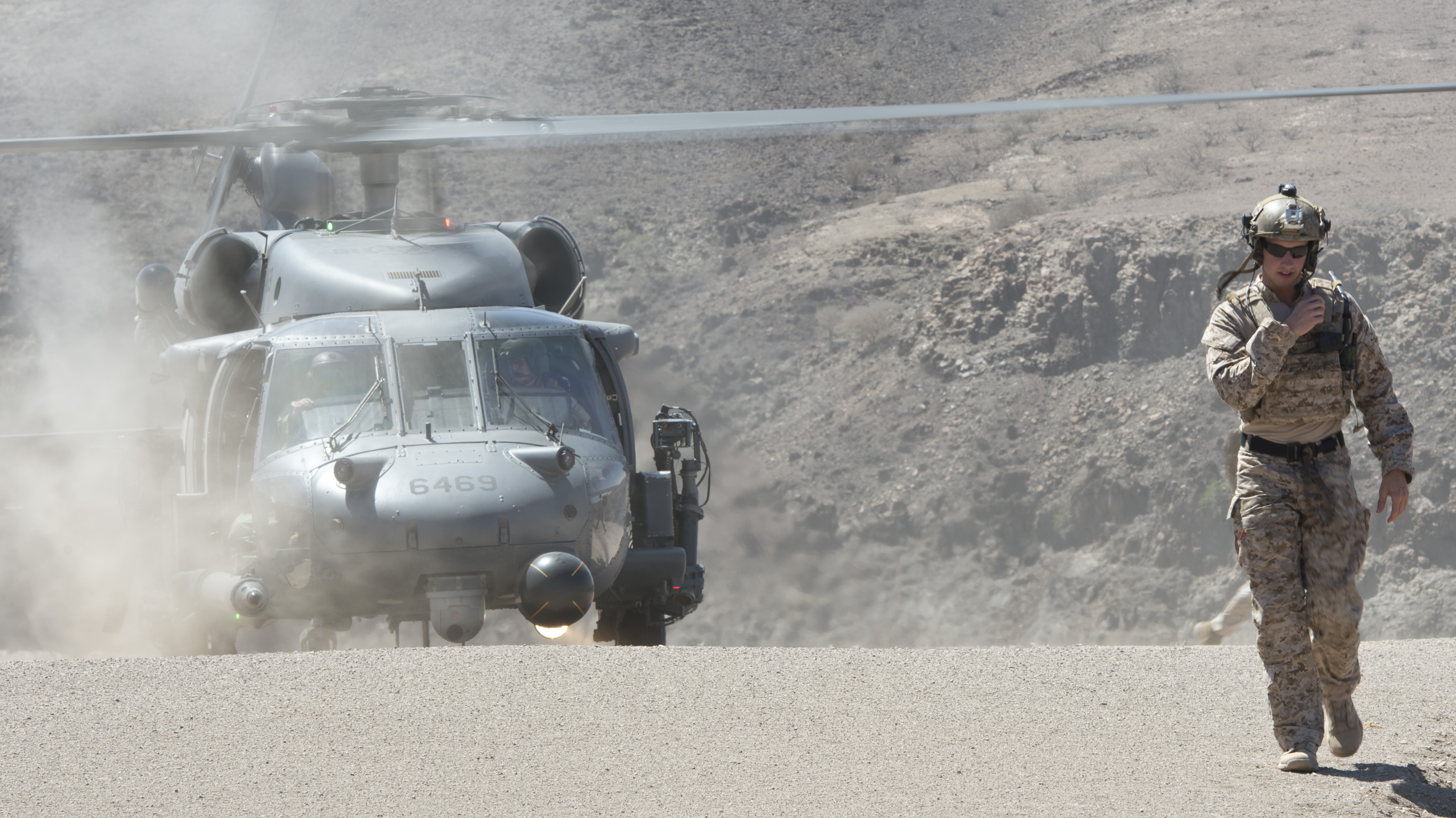 A U.S. Air Force HH-60 Pave Hawk from the 303rd Expeditionary Rescue Squadron prepares to take off after conducting a casualty evacuation drill during a bilateral training exercise in Arta, Djibouti, Feb. 4, 2015. The event was part of a scheduled bilateral close air support exercise between the 24th Marine Expeditionary Unit and French soldiers and sailors. (U.S. Air Force photo by Staff Sgt. Kevin Iinuma)
