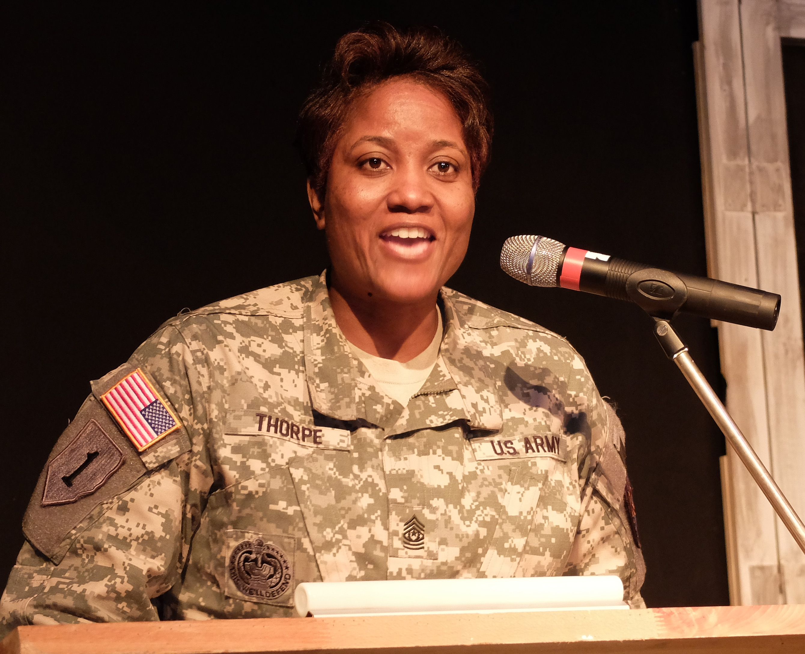 "U.S. Army Garrison Command Sgt. Major Lynice Thorpe delivers remarks. ""A Century of Black Life, History and Culture"" served as the theme for this year's Black History Month celebration, held at Kelley Barracks, U.S. Army Garrison Stuttgart, Feb. 26, 2015.  Performances by the Patch High School and Stuttgart Gospel Service Choirs and a dance from the play ""Her Stories"" highlighted the accomplishments of African Americans over the past century. (U.S. Africa Command photos by Brenda Law/Released)"