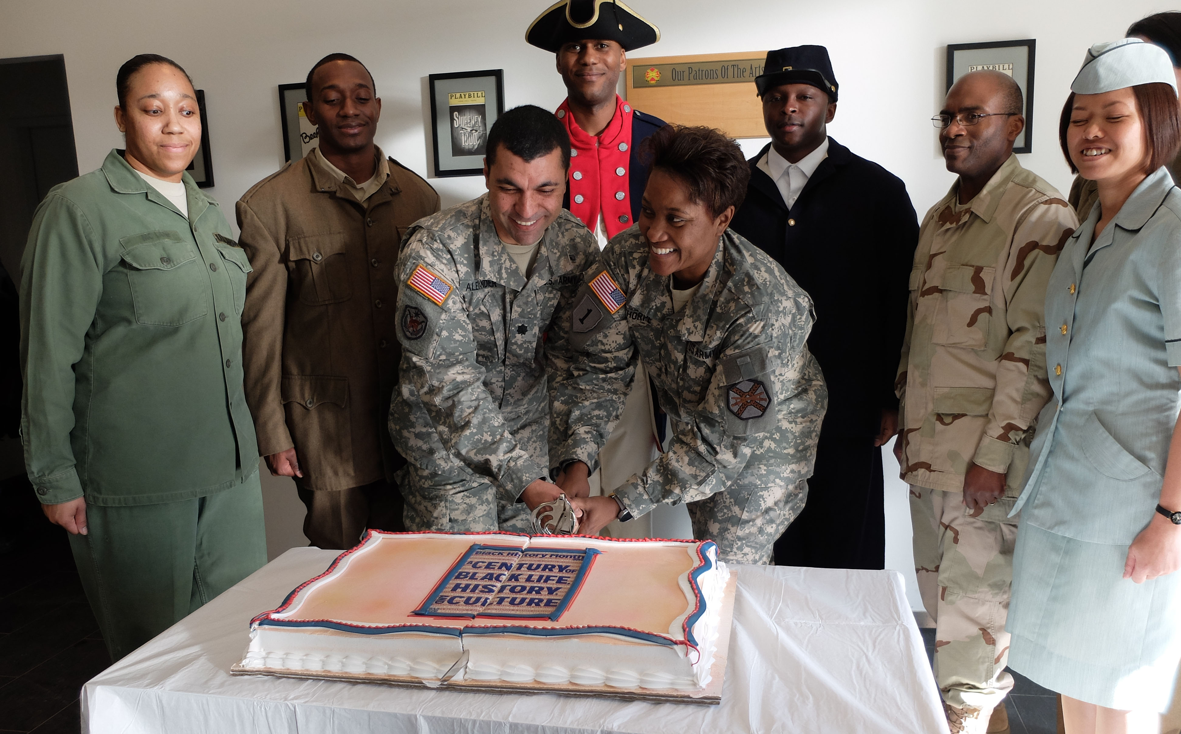 "U.S. Army Garrison Command Sgt. Major Lynice Thorpe (right) and AFRICOM Headquarters Commandant, U.S. Army Lt. Col. Troy Alexander, cut the cake. ""A Century of Black Life, History and Culture"" served as the theme for this year's Black History Month celebration, held at Kelley Barracks, U.S. Army Garrison Stuttgart, Feb. 26, 2015.  Performances by the Patch High School and Stuttgart Gospel Service Choirs and a dance from the play ""Her Stories"" highlighted the accomplishments of African Americans over the past century. (U.S. Africa Command photos by Brenda Law/Released)"