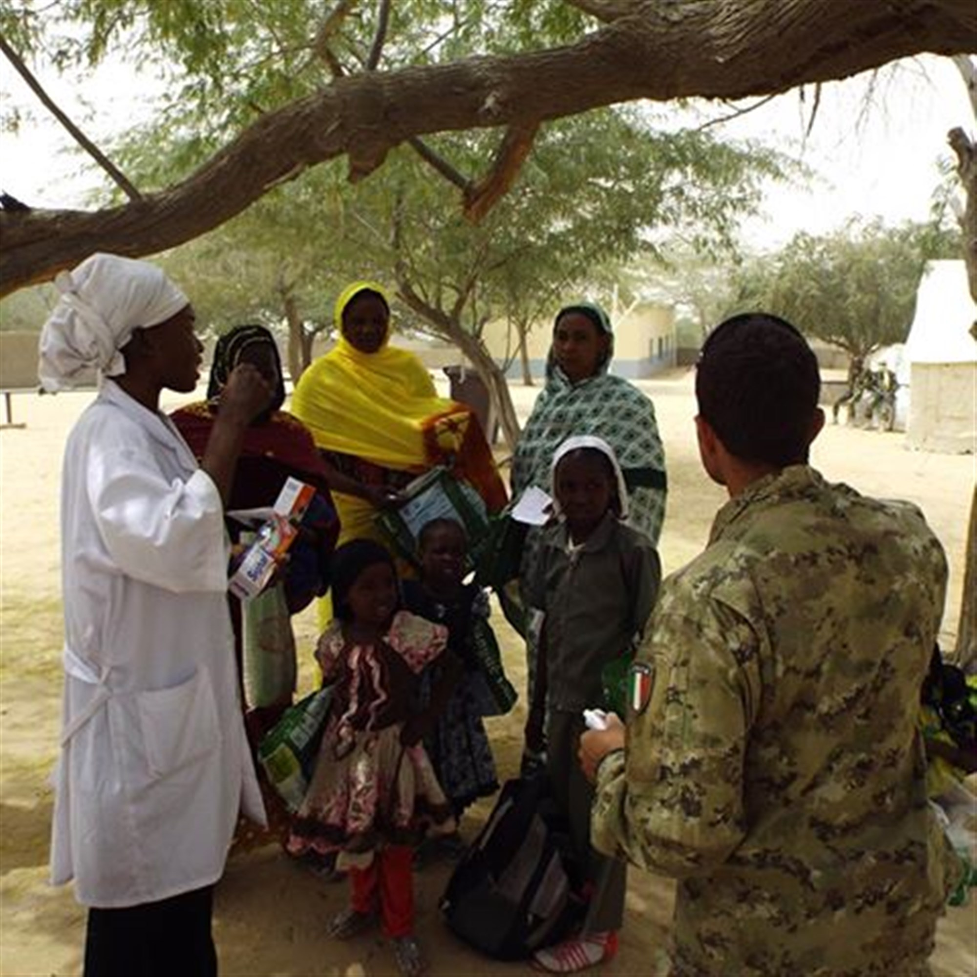 Chadians receive information about treatment from medical care personnel during Exercise Flintlock 2015.
