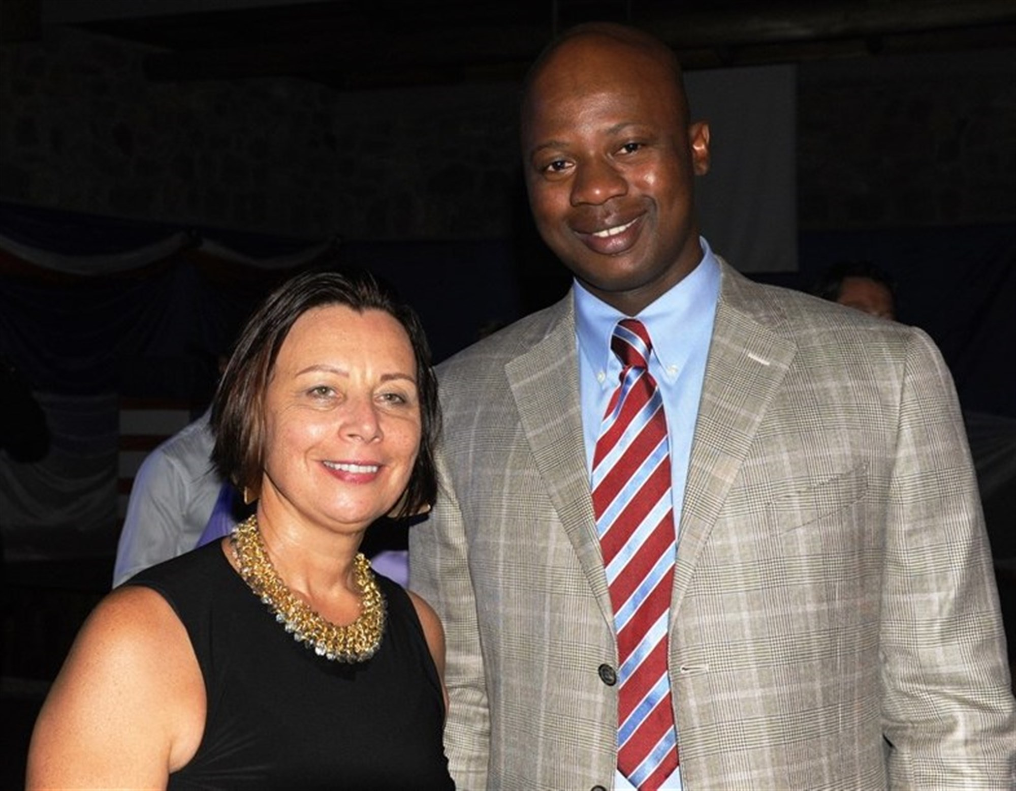 2nd Lt. Komi Afetse, Combined Joint Task Force-Horn of Africa, and Ambassador Dawn Liberi, U.S. Ambassador to the Republic of Burundi, pose for a photo during the 239th Marine Corps Birthday Celebration in Bujumbura, Burundi, Nov. 8, 2014. Afetse immigrated to the U.S. from Togo, and earned his commission through the Army Reserve Officer Accession Program on Feb. 14, 2015.  (U.S. Navy photo by Chief Mass Communication Specialist Allison Pittam/Released)