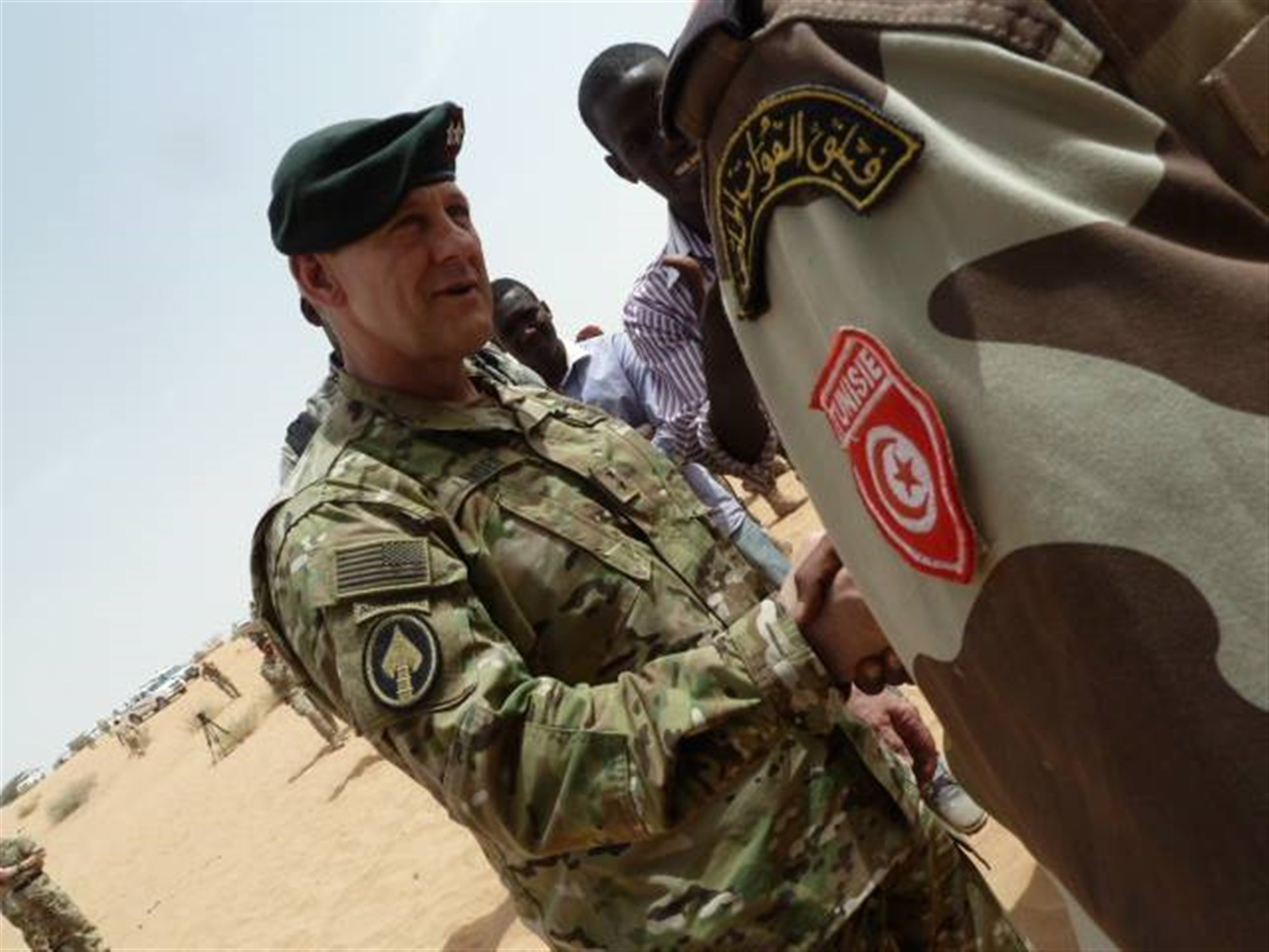 Special Operations Command Africa Commander General, U.S. Army Maj. Gen. James Linder, congratulates Tunisian special forces after a successful multi-national demonstration on Mar. 7, 2015 in the vicinity of Mao, Chad. The soldiers completed three weeks of training in austere conditions as part of the Flintlock 2015 exercise. (Photo by U.S. Air Force Maj. Nathan Broshear/RELEASED)