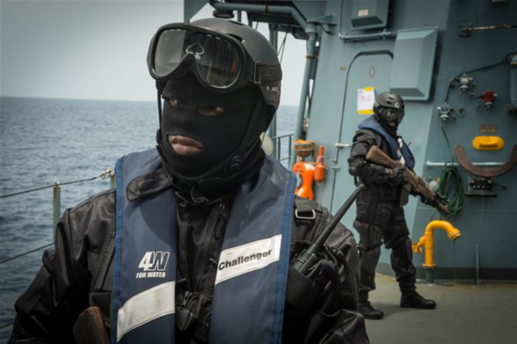 Ivory Coast boarding team members establish perimeter security aboard the German navy vessel FGS Brandenburg (F215) March 21, 2015 during an illegal fishing training scenario as part of Obangame Express 2015. Obangame Express is a U.S. Africa Command-sponsored multinational maritime exercise designed to increase maritime safety and security in the Gulf of Guinea. (U.S. Army photo by Specialist Raul Pacheco/Released)