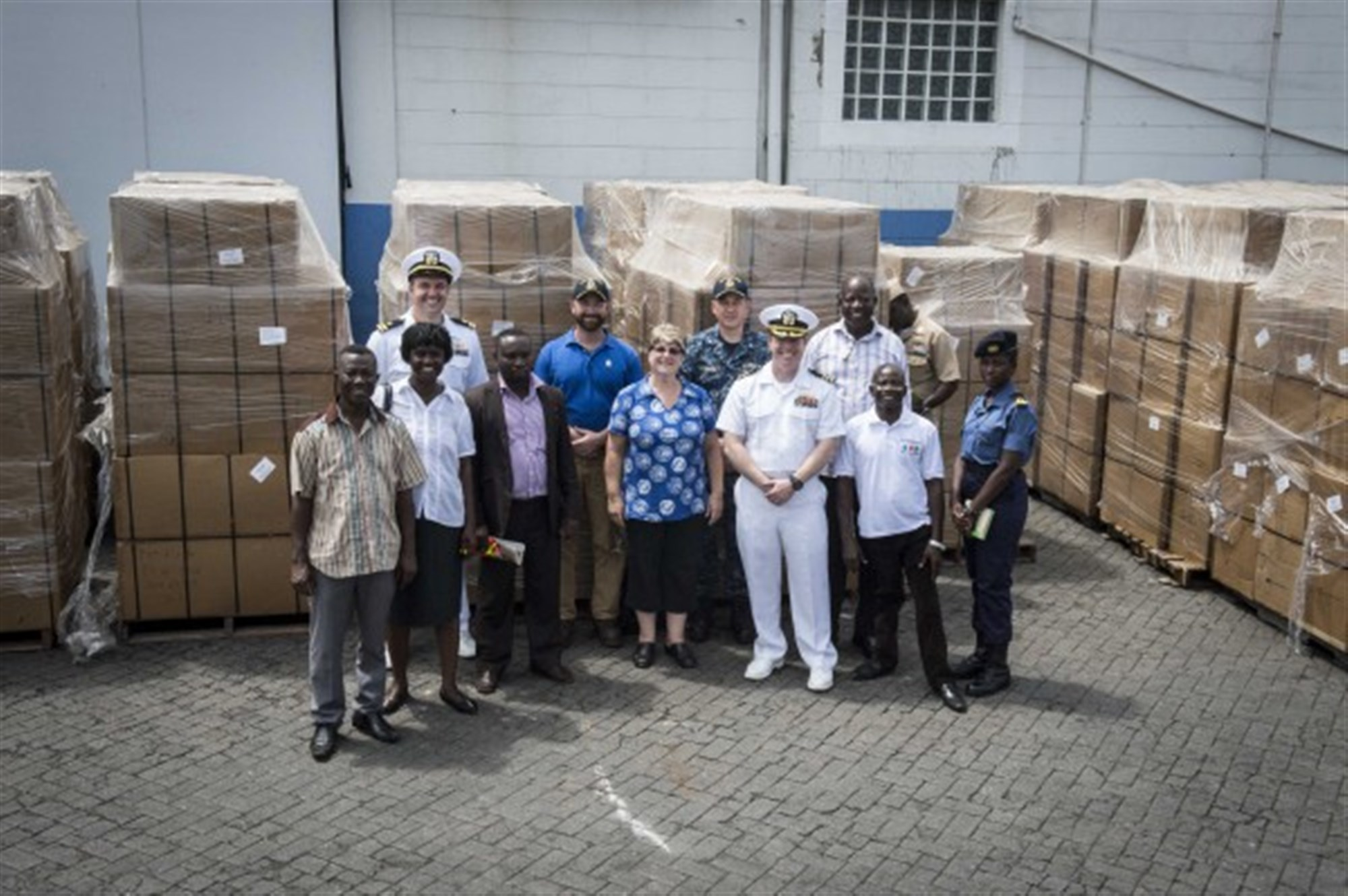 Members of Project Handclasp and service members from the U.S. and Ghanaian military pose for a photo in front of Project Handclasp supplies, delivered from the Military Sealift Command's joint high-speed vessel USNS Spearhead (JHSV 1) March 26, 2015. Spearhead is on a scheduled deployment to the U.S. 6th Fleet area of operations in support of the international collaborative capacity-building program Africa Partnership Station. (U.S. Navy photo by Mass Communication Specialist 2nd Class Kenan O'Connor/Released)