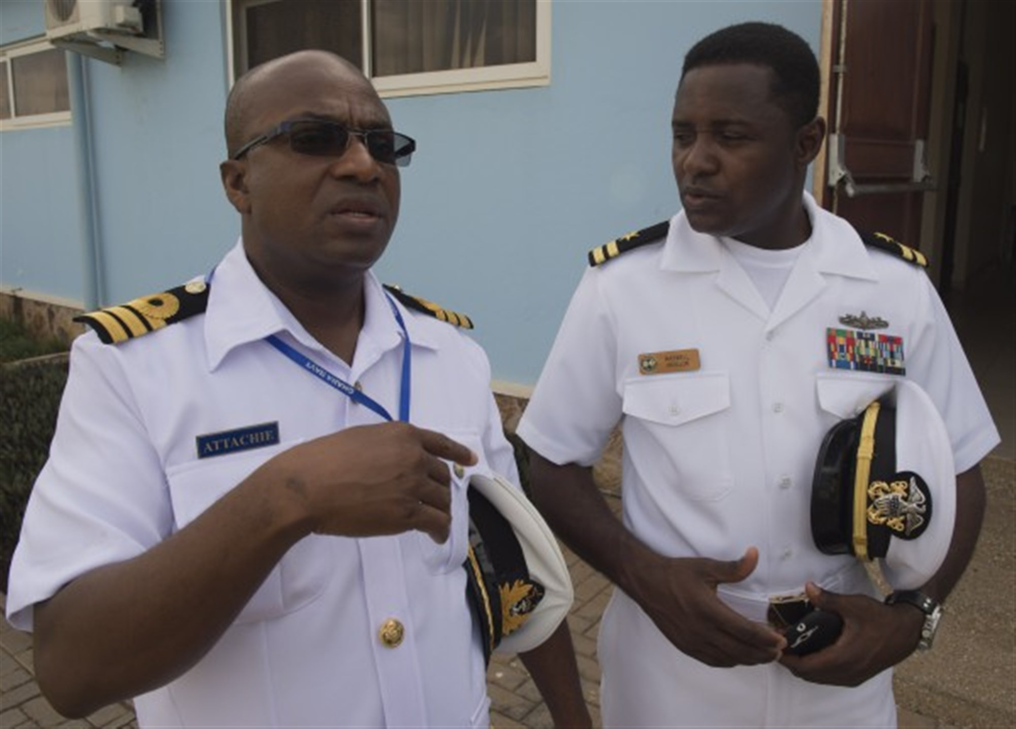 Lt. Maxwell Annani, right, speaks with his Ghanaian counterpart before the Exercise Obangame Express closing ceremony March 27, 2015. Obangame Express is a U.S. Africa Command-sponsored multinational maritime exercise designed to increase maritime safety and security in the Gulf of Guinea. (U.S. Navy photo by Mass Communication Specialist 1st Class David R. Krigbaum/Released)