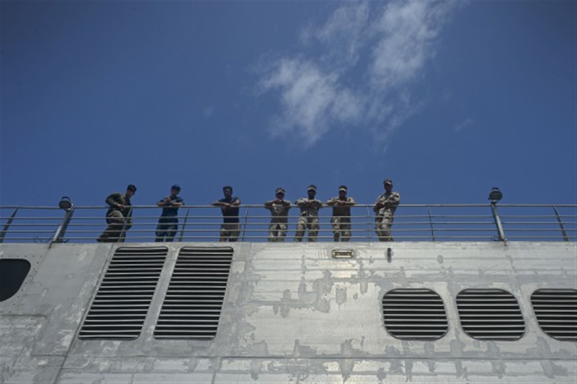 150406-N-RB579-019 PORT GENTIL, Gabon (April 6, 2015) Sailors stand on the flight deck of the Military Sealift Command's joint high-speed vessel USNS Spearhead (JHSV 1) after the ship pulls into Port Gentil, Gabon April 6, 2015. Spearhead is on a scheduled deployment to the U.S. 6th Fleet area of operations in support of the international collaborative capacity-building program Africa Partnership Station. (U.S. Navy photo by Mass Communication Specialist 1st Class Joshua Davies/Released)