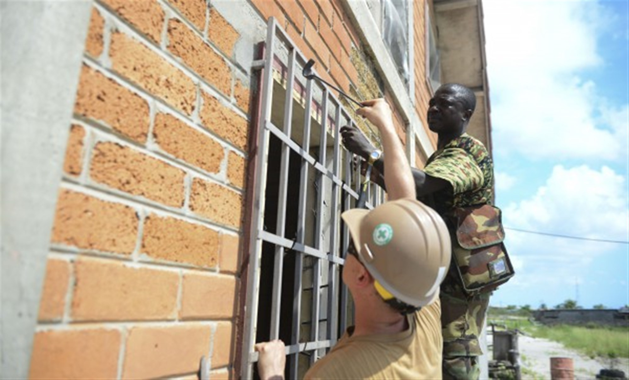 Seabees assigned to Navy Mobile Construction Battalion (NMCB) 11 and members of the Gabonese military work together to refurbish the Centre Esperance Mission orphanage in Port Gentile, Gabon, April 8, 2015. Embarked military and civilian mariners assigned to the joint high-speed vessel USNS Spearhead (JHSV 1), Seabees from NMCB 11, members of the Gabonese military worked together to help renovate the orphanage. Spearhead is on a scheduled deployment to the U.S. 6th Fleet area of operations in support of the international collaborative capacity-building program Africa Partnership Station.
