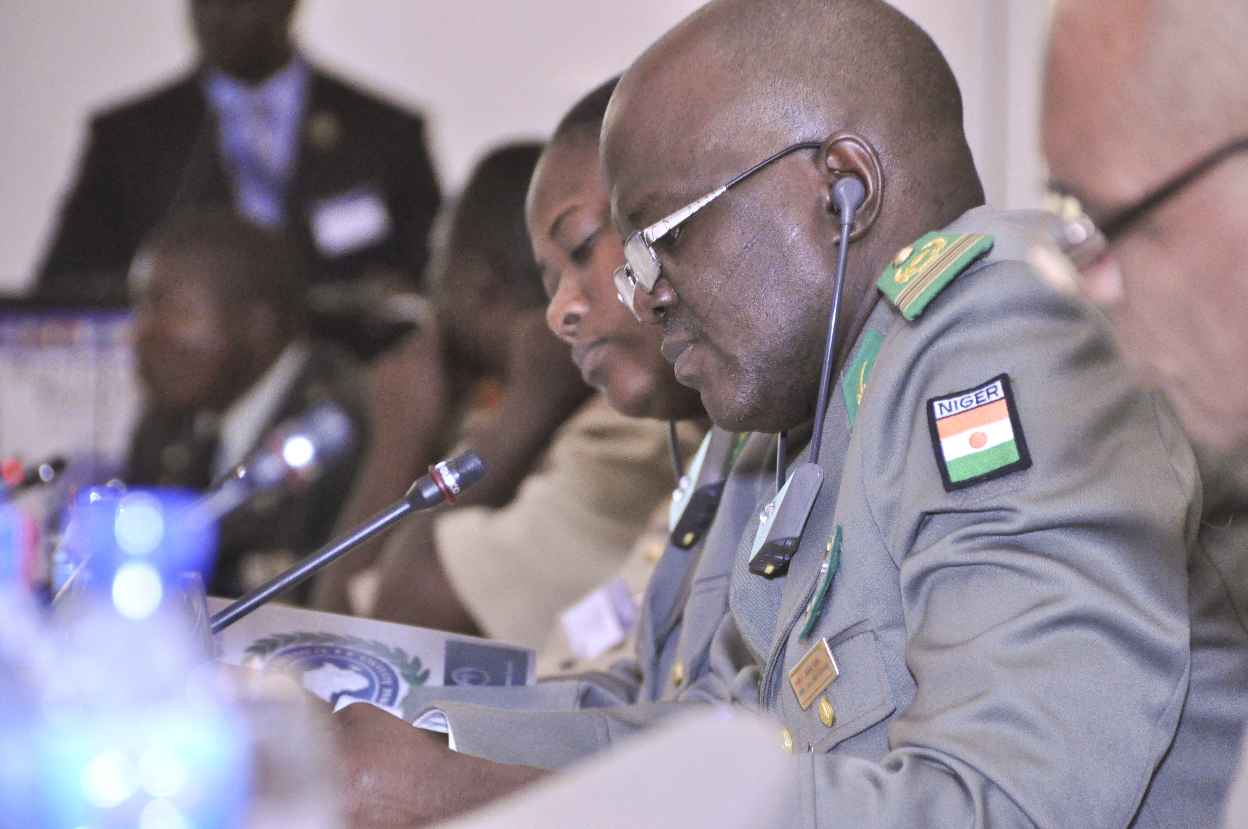 Participants take notes during the lesson-learned presentation by members of the Liberian Armed Forces during the first African Partner Outbreak Response Alliance meeting in Accra, Ghana, April 20, 2015.  More than 60 military and civilian doctors and medical practitioners from 12 African nations attended the meeting to discuss the capabilities of African partner nations to respond to a disease outbreak. (U.S. Africa Command photo by Tech. Sgt. Olufemi A Owolabi)