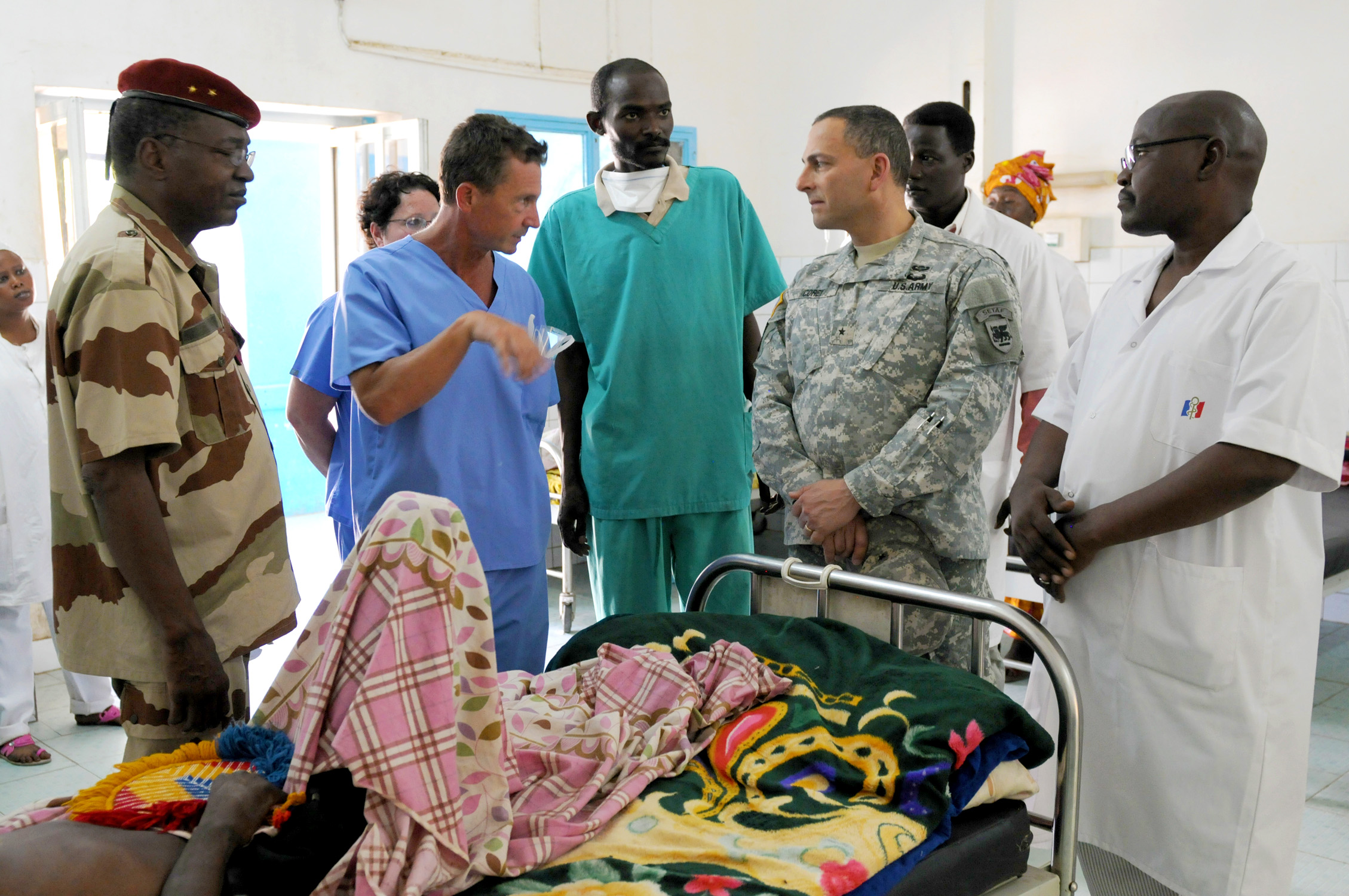Brig. Gen. Peter Corey, the deputy commanding general of U.S. Army Africa, walks through the patients' ward at the Hospital Militaire D'Instruction in N'Djamena, Chad, April 23. While at HMI, Corey visited the labs, patient wards, and operating rooms. He also observed a surgery and checked in with the U.S. Army Soldiers participating in Medical Readiness and Training Exercise 15-3. The Soldiers have been in Chad for nearly two weeks working alongside Chadian hospital staff conducting consultations with patients, performing and assisting in surgeries, and assessing and treating trauma patients. (U.S. Army Africa photo by Staff Sgt. Andrea Merritt)