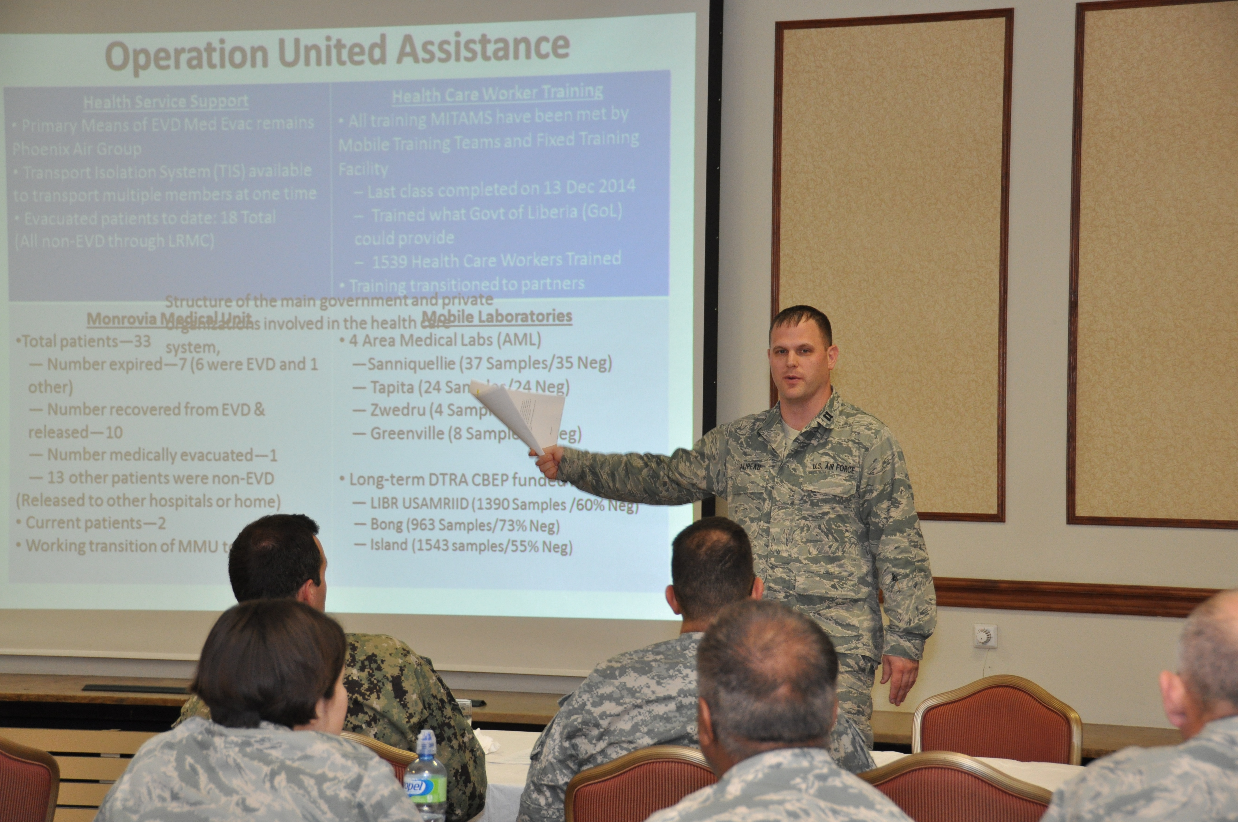 U.S. Air Force Capt. Jason T. Galipeau, medical planner at the AFRICOM Surgeon's Office, briefs about the command support to Operation United Assistance during a three-day Global Health Engagement (GHE) and Medical Stability Operations (MSO) course held in Stuttgart, Germany. April 27-29, 2015.  More than 40 medical experts from U.S. Africa Command, its subordinate commands and the United States attended the course held in Stuttgart, Germany, to build an awareness of the complex set of variables that shape the development of Department of Defense Global Health Engagement (GHE) and Medical Stability Operations (MSO).  and to also help medical practitioners here gain an understanding of the key principles to plan and conduct a GHE/MSO activity. The course was hosted by the AFRICOM command surgeon's office.  (AFRICOM photo by Tech. Sgt. Olufemi A. Owolabi)