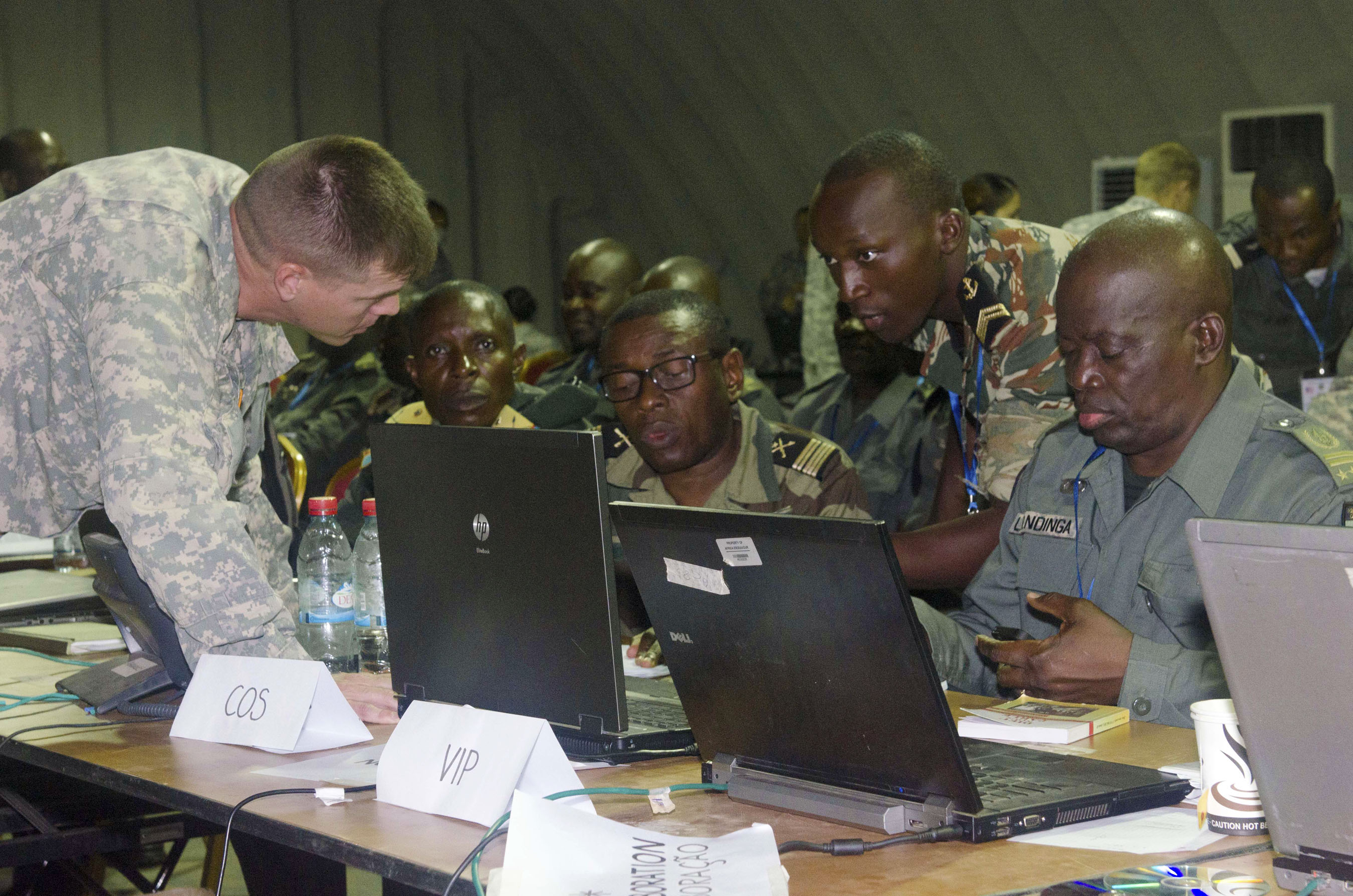 Lt. Col. Jonathan Shine, commander, 4th Battalion, 1st Field Artillery Regiment, 3rd Brigade, 1st Armored Division, works  with central African military personnel during the preparation phase of Central Accord 2015 in Libreville, Gabon, May 14. Shine and his counterparts  developed a plan of action for events taking place during the exercise. CA 15 exercises mission command proficiency for UN peacekeeping operations, develops multinational logistical and communications capabilities, and improves regional ability to command, control and support forward deployed forces. Approximately 400 military personnel from member nations are scheduled to participate in the exercise. The exercise consists of one week of classroom-based academics and one week of a command post exercise. (U.S. Army Africa photo by Staff Sgt. Michael Folkerth)
