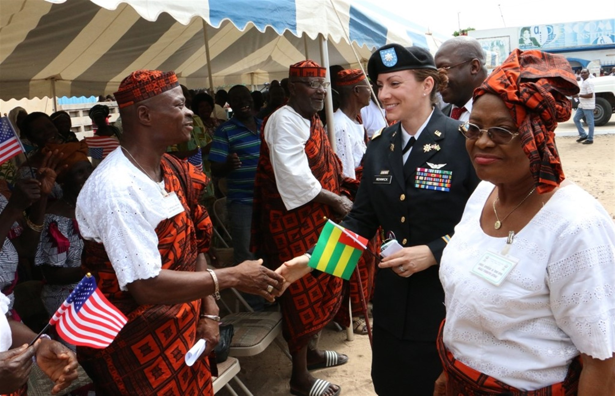 Lt. Col. Lori Renwick, manager of the AFRICOM Humanitarian and Civic Assistance Program, greets community leaders during a ribbon cutting ceremony for a healthcare facility in Lomé, Togo May 26, 2015. Photo taken by Elliott Agbavon, U.S. Embassy Lomé.