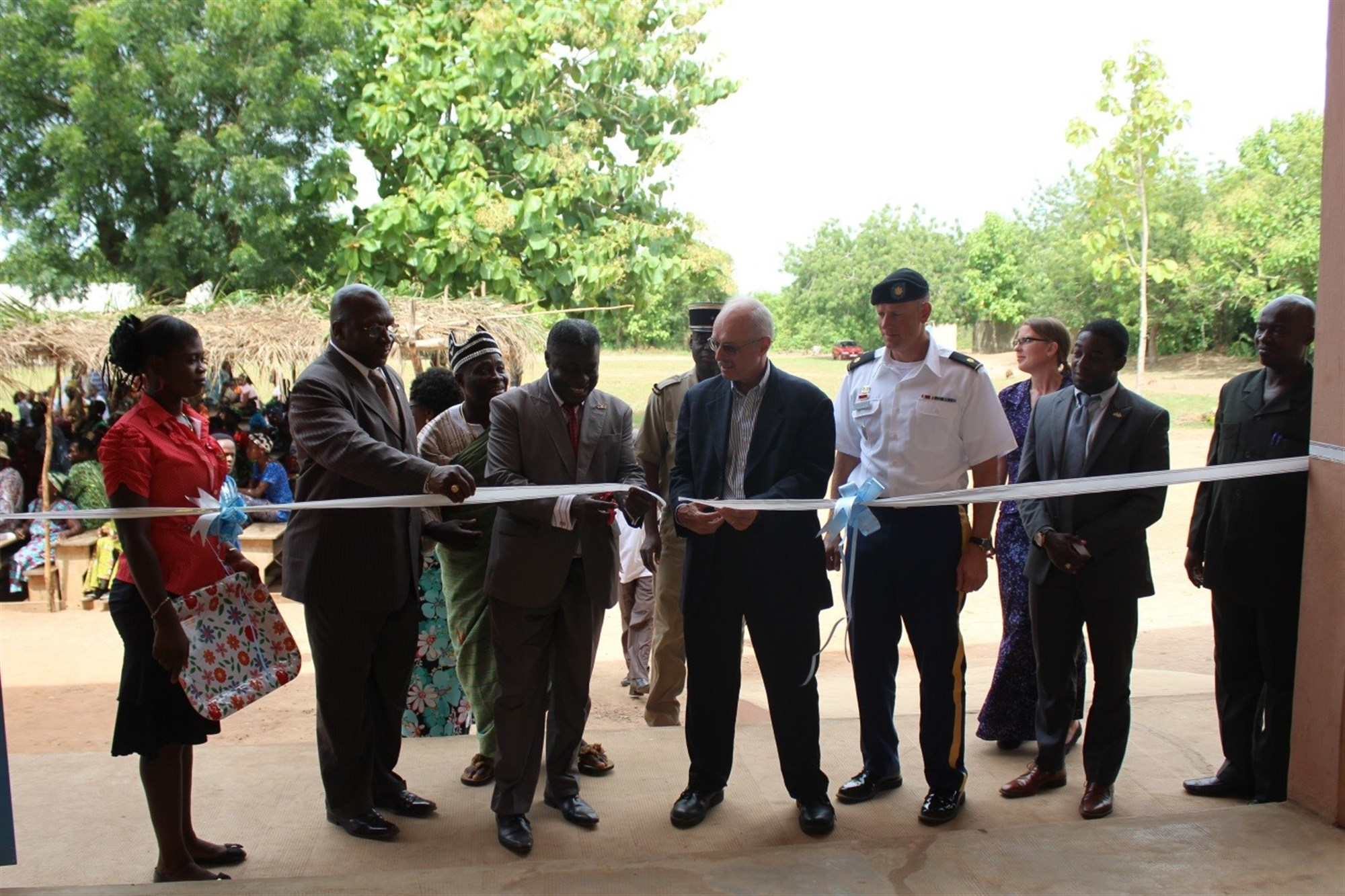Ambassador Robert E. Whitehead marks the opening of a primary school during a ribbon cutting ceremony in Atomé, Togo, May 28, 2015. U.S. Africa Command funded the construction through the Humanitarian and Civic Assistance Program. Photo by Ben Simyeli, U. S. Embassy Lomé.