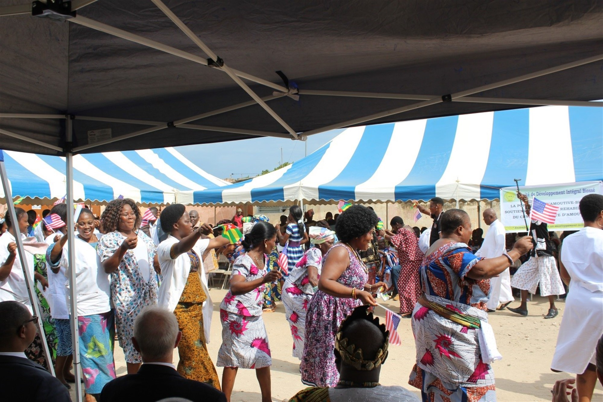 People dance during a ceremony to mark the start of construction on a healthcare facility for women in Amoutivé, Togo, May 26, 2015. U.S. Africa Command funded the project through the Humanitarian and Civic Assistance Program. Photo by Lauren McCaughey, U.S. Embassy Lomé.