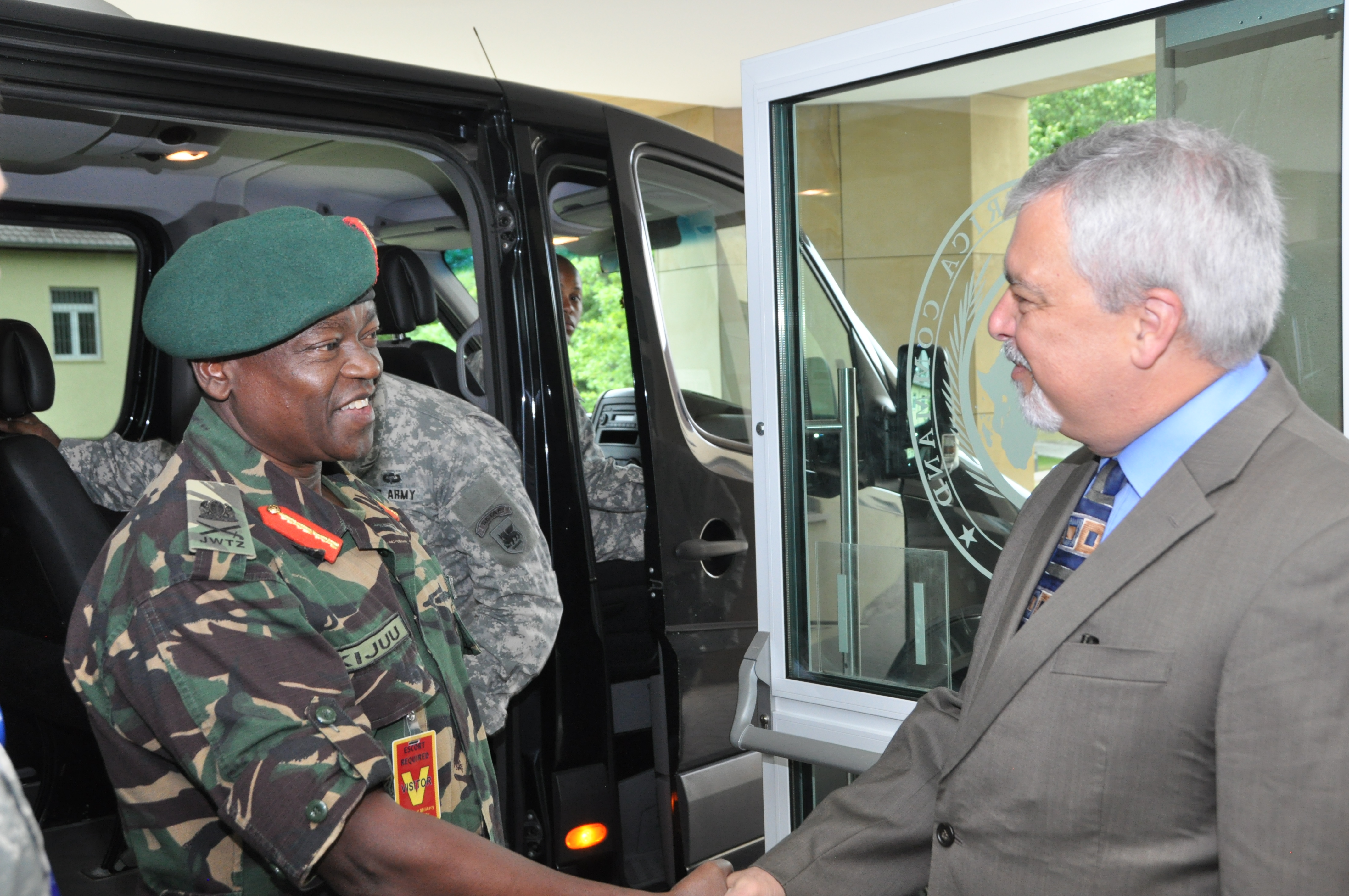 Ambassador Phillip Carter, III, deputy to the commander for civil-military engagement, greets Maj. Gen. Salim Mustafa Kijuu, land force commander of the Tanzanian People's Defence Force, during of a command sponsored visit coordinated by U.S. Army Africa July 8, 2015.