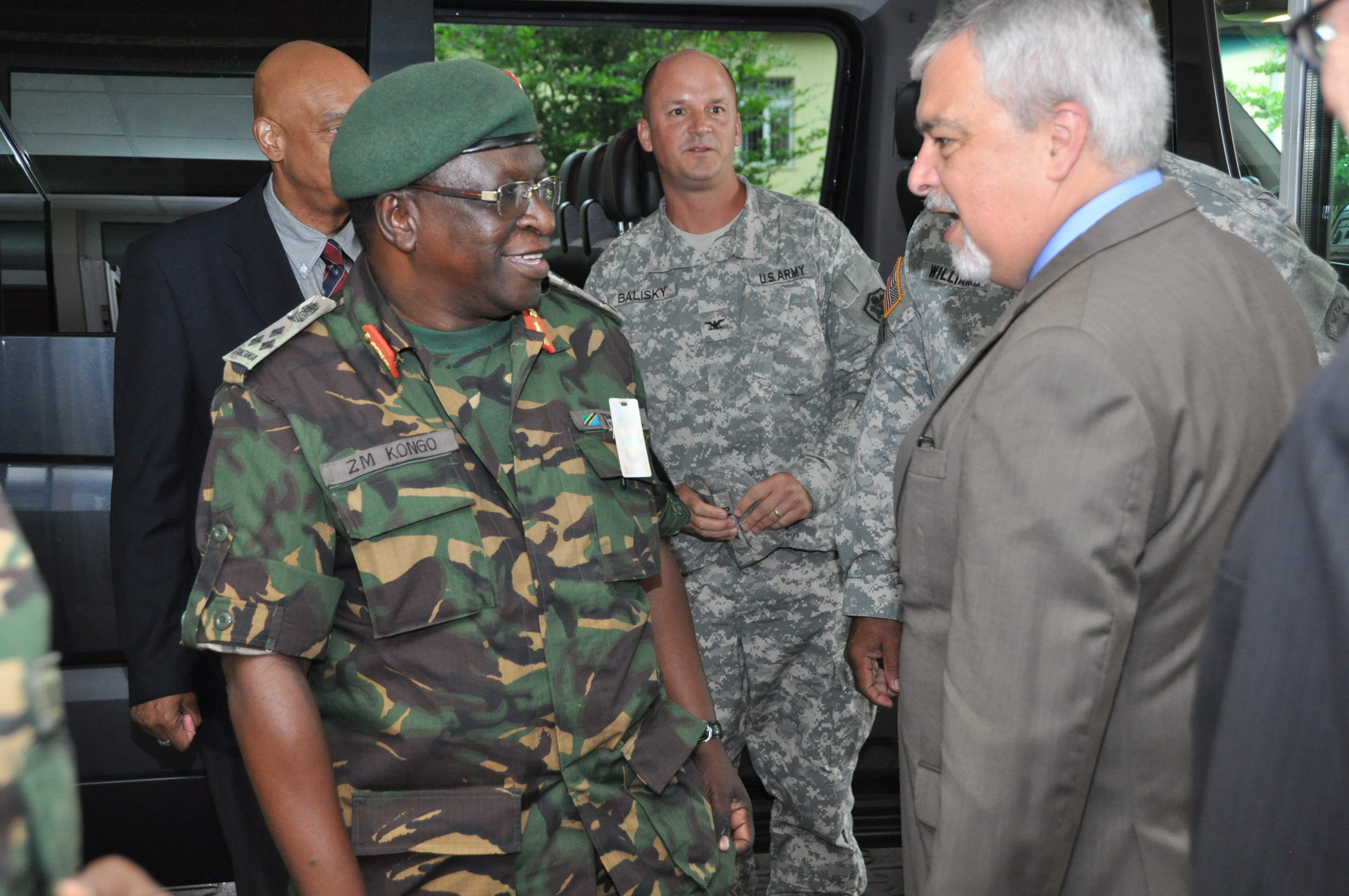 Ambassador Phillip Carter, III, U.S. Africa Command deputy to the commander for civil-military engagement, greets Brig. Gen. Gen. Zoma Mathik Kongo,  director of operations for the Tanzanian People's Defence Force during of a Command Sponsored Visit, coordinated by U.S. Army Africa July 8, 2015.