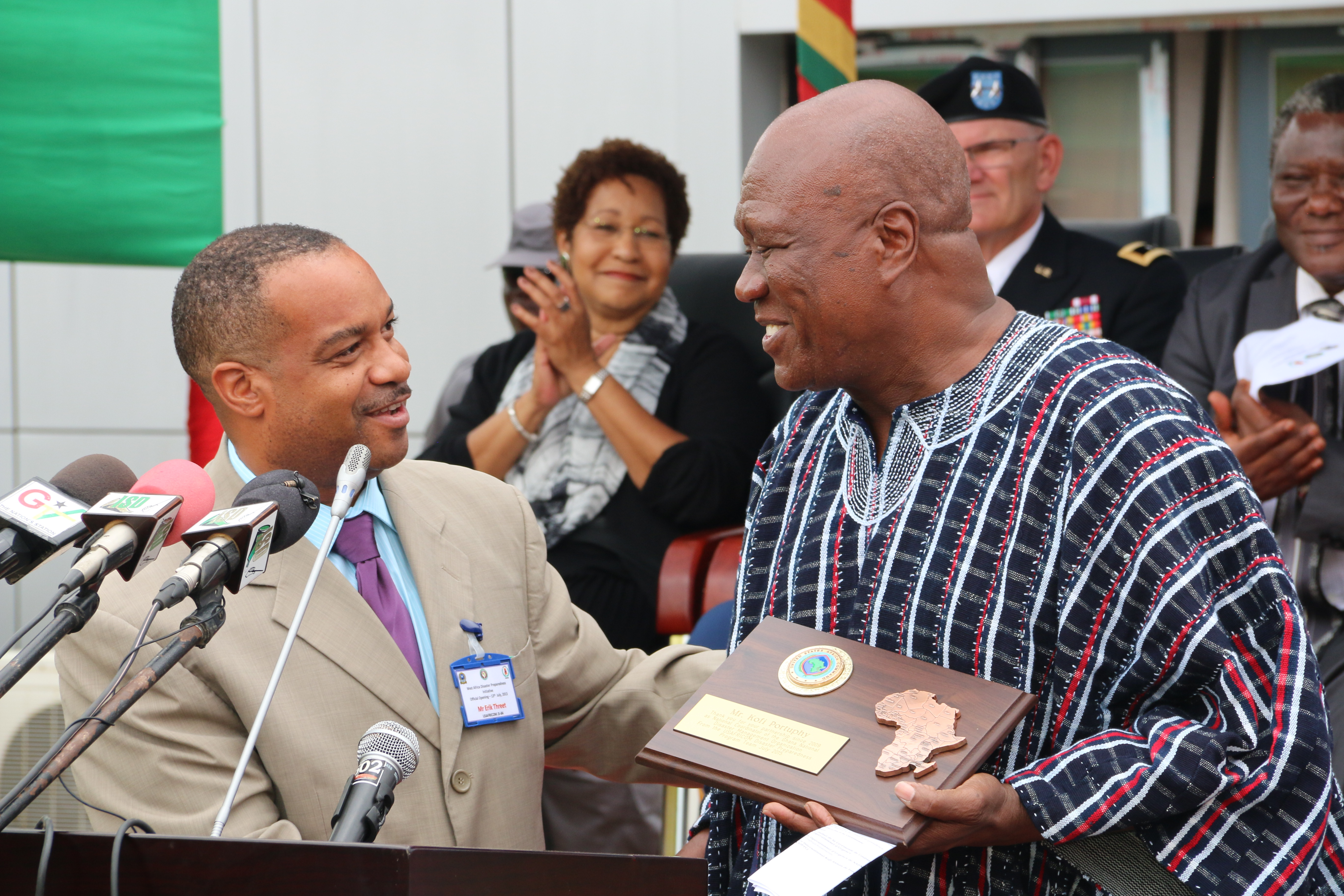 Erik Threet, left, disaster preparedness program manager with U.S. Africa Command, presents an award for service to Sir Ebeneezer Kofi Portuphy, former national coordinator for Ghana's National Disaster Management Organization, in Accra, Ghana July 13, 2015.