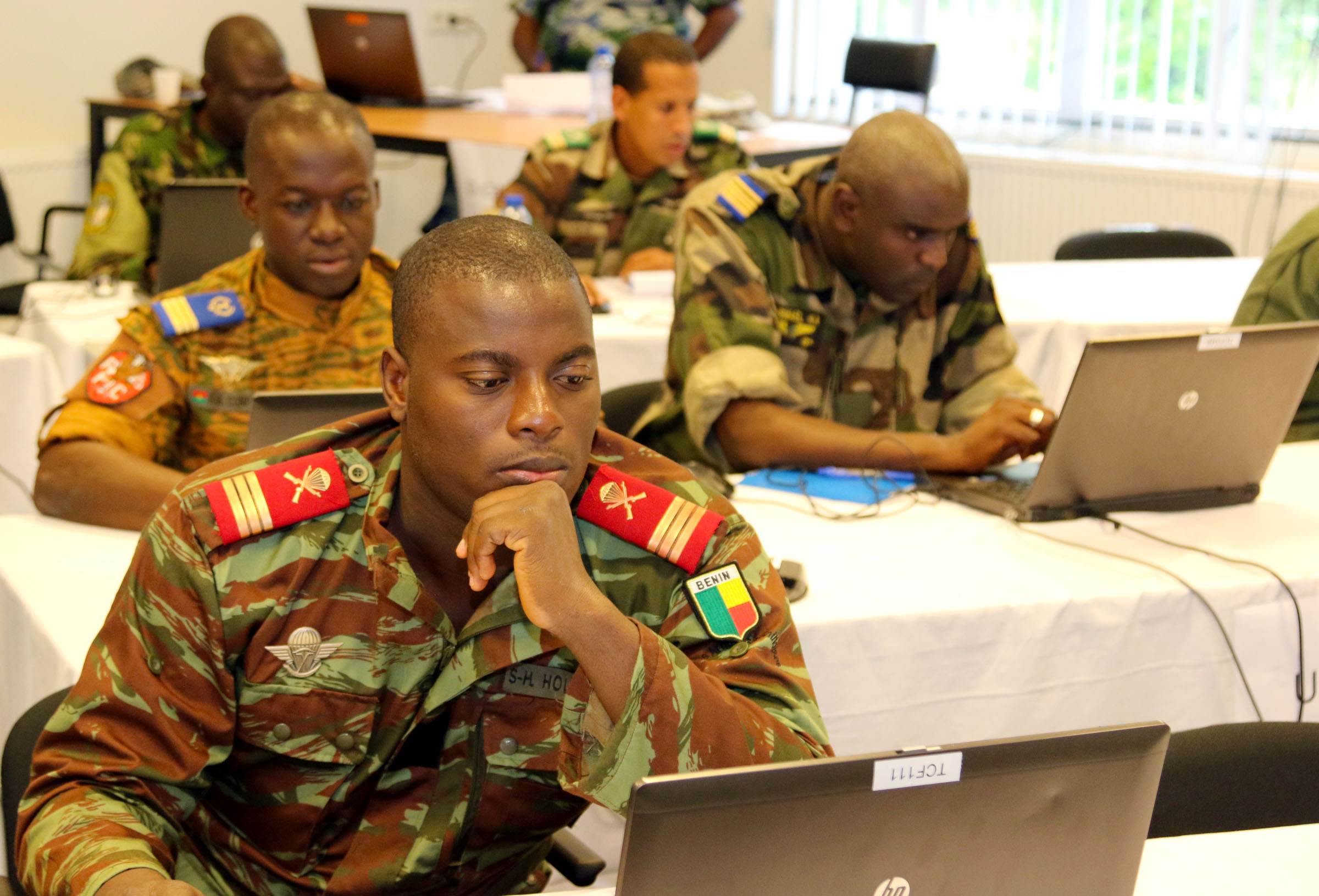 Staff members participating in Western Accord 2015 prepare for the upcoming command post exercise at Winkelman Kazerne, Harskamp, The Netherlands, July 22. The exercise benefits participating militaries and encourages them to work together in preparation for multi-national responses to peacekeeping and humanitarian operations. (U.S. Army Africa photo by Staff Sgt. Killo Gibson)