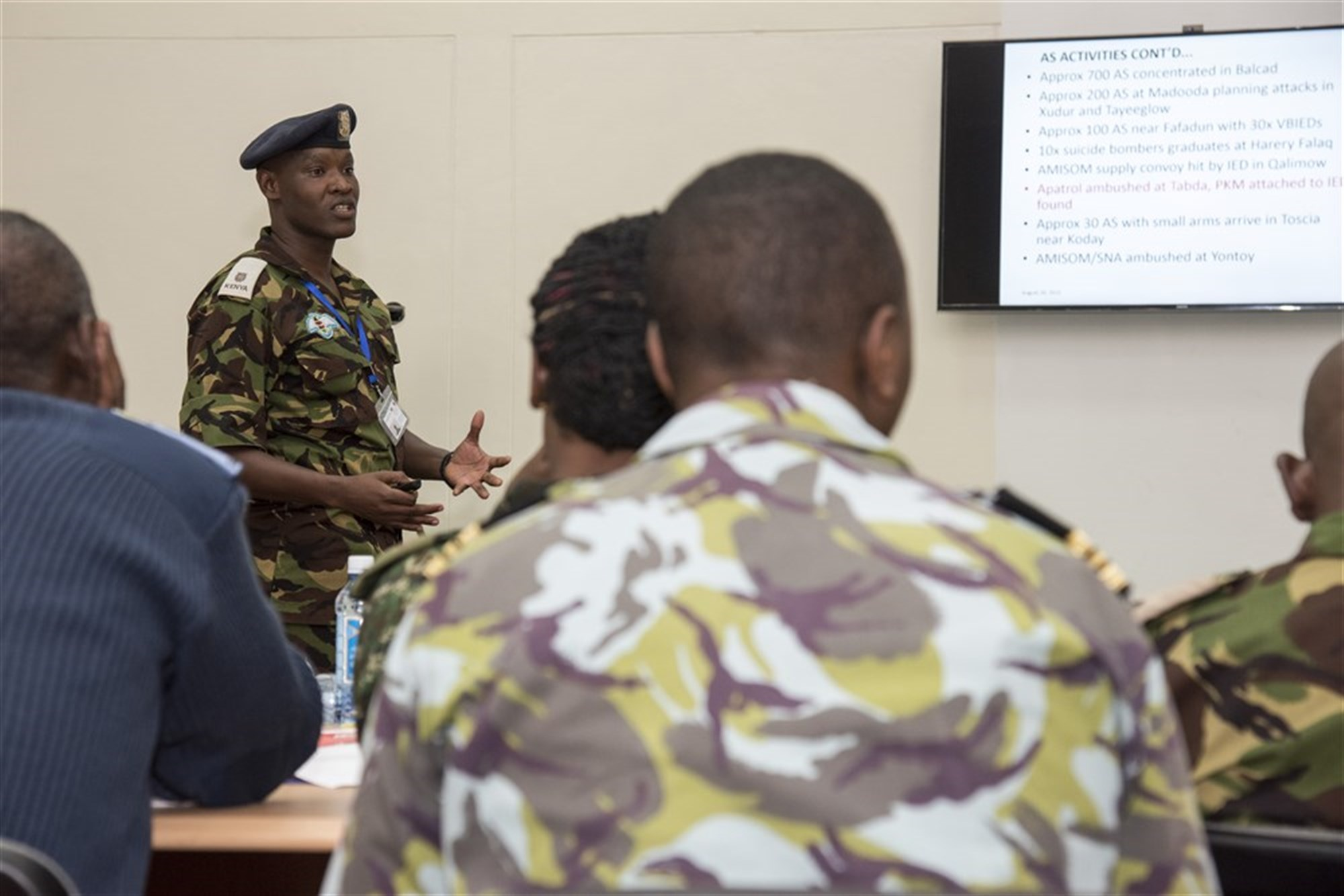 Kenyan Defense Force Maj. David Nzuve, Africa Contingency Operations Training & Assistance (ACOTA) African Union Mission in Somalia (AMISOM) Force Headquarters training course attendee, briefs command staff officers during a culmination exercise at the International Peace Support Training Center in Nairobi, Kenya, Aug. 26, 2015. The course was designed to prepare staff officers from AMISOM contributing countries for possible assignment to AMISOM Force Headquarters as a part of the command staff there, and as staff members the officers were asked to prepare daily briefings regarding the day's events. (U.S. Air Force photo by Staff Sgt. Nathan Maysonet/released)