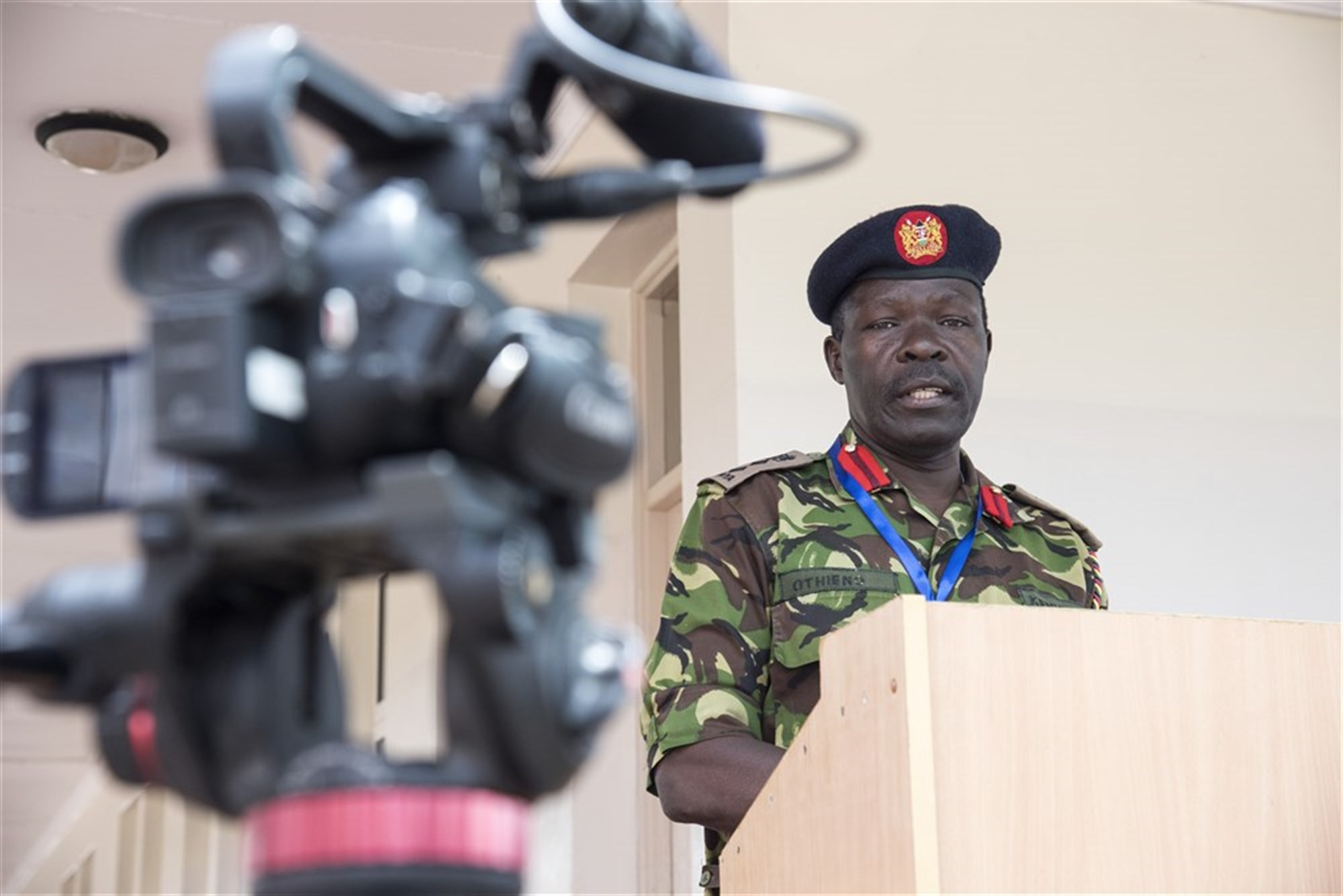 Kenyan Defense Force Col. Shadrack Othieno, Africa Contingency Operations Training & Assistance (ACOTA) African Union Mission in Somalia (AMISOM) Force Headquarters training course attendee, briefs the media during a mock press conference at the International Peace Support Training Center in Nairobi, Kenya, Aug. 25, 2015. The course was designed to prepare staff officers from AMISOM contributing countries for possible assignment to AMISOM Force Headquarters, the public affairs training is to prepare PA teams for the significant media presence in Somalia. (U.S. Air Force photo by Staff Sgt. Nathan Maysonet/released)