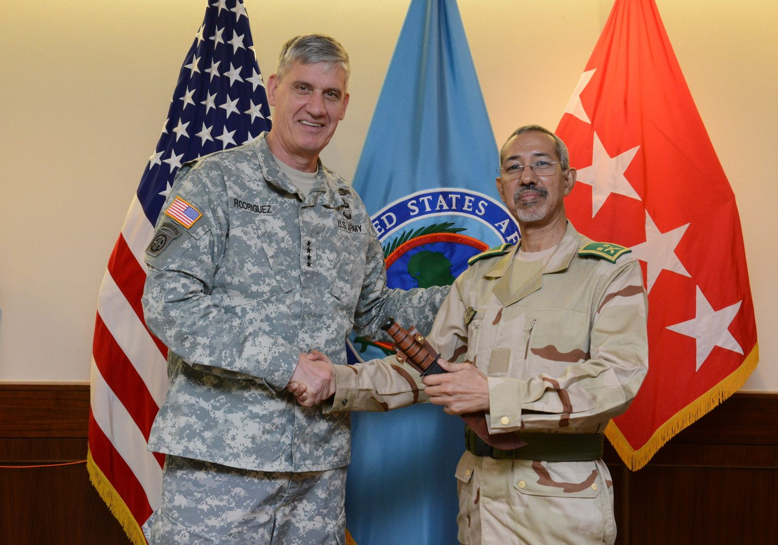 U.S. Army Gen. David Rodriguez, commander of U.S. Africa Command, and Mauritania Brig. Gen. Hanana Sidi Hanana, deputy chief of defense for Mauritania, pose for a photo during a gift exchange in Stuttgart, Germany, Sept. 1, 2015. Hanana visited AFRICOM to discuss how the U.S. military plans and conducts joint operations at the strategic level.