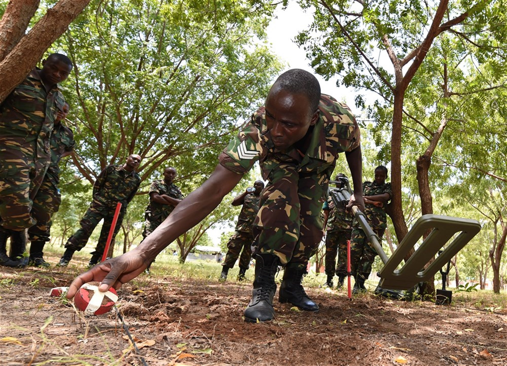 Sgt. Gaudence Siame, Tanzania People's Defense Force ammunition technician, places a metal shape aside during a metal detector familiarization class at the Peace Keeping Training Center in Dar es Salaam, Tanzania Aug. 23, 2015. Two U.S. Navy Explosive Ordnance Disposal technicians, assigned to Combined to Joint Task Force- Horn of Africa, instructed a three-week Humanitarian Mine Action course to TPDF ammunition technicians and officers in order to increase ordnance knowledge.