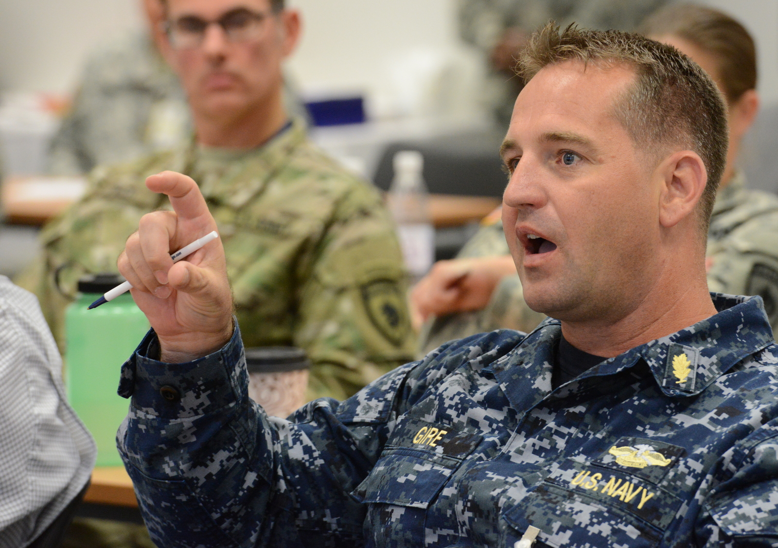 U.S. Navy Lt. Cdr. Randy Gire, a medical planner with U.S. Naval Forces Europe and Africa, asks a question during the 2015 AFRICOM Command Surgeon's Conference at Kelley Barracks, U.S. Army Garrison Stuttgart, Germany, Sept. 10, 2015. The conference was a forum for medical providers and officers from U.S. component commands and partner nations to discuss how their medical operations collectively support AFRICOM's theater campaign plan.
