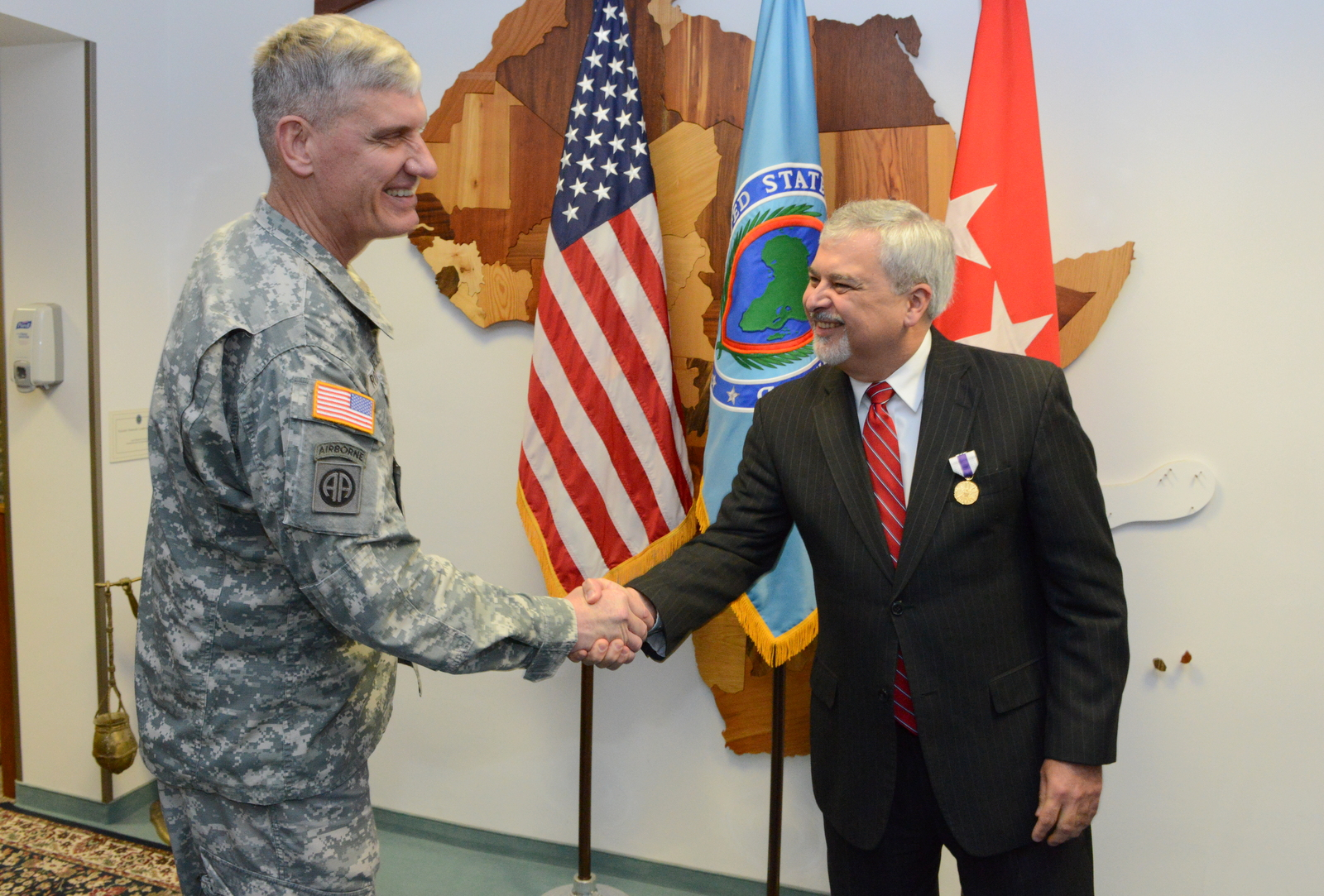 U.S. Army Gen. David Rodriguez, left, commander of U.S. Africa Command, shakes hands with Ambassador Phillip Carter III, the command's outgoing deputy to the commander for civil military engagement, after awarding Carter the Joint Distinguished Civilian Service Medal at Kelley Barracks, U.S. Army Garrison Stuttgart, Germany, Sept. 17, 2015. Before becoming the command's senior diplomat and civilian advisor to the commander in November 2013, Carter served as the U.S. Ambassador to Republic of Cote d'Ivoire.
