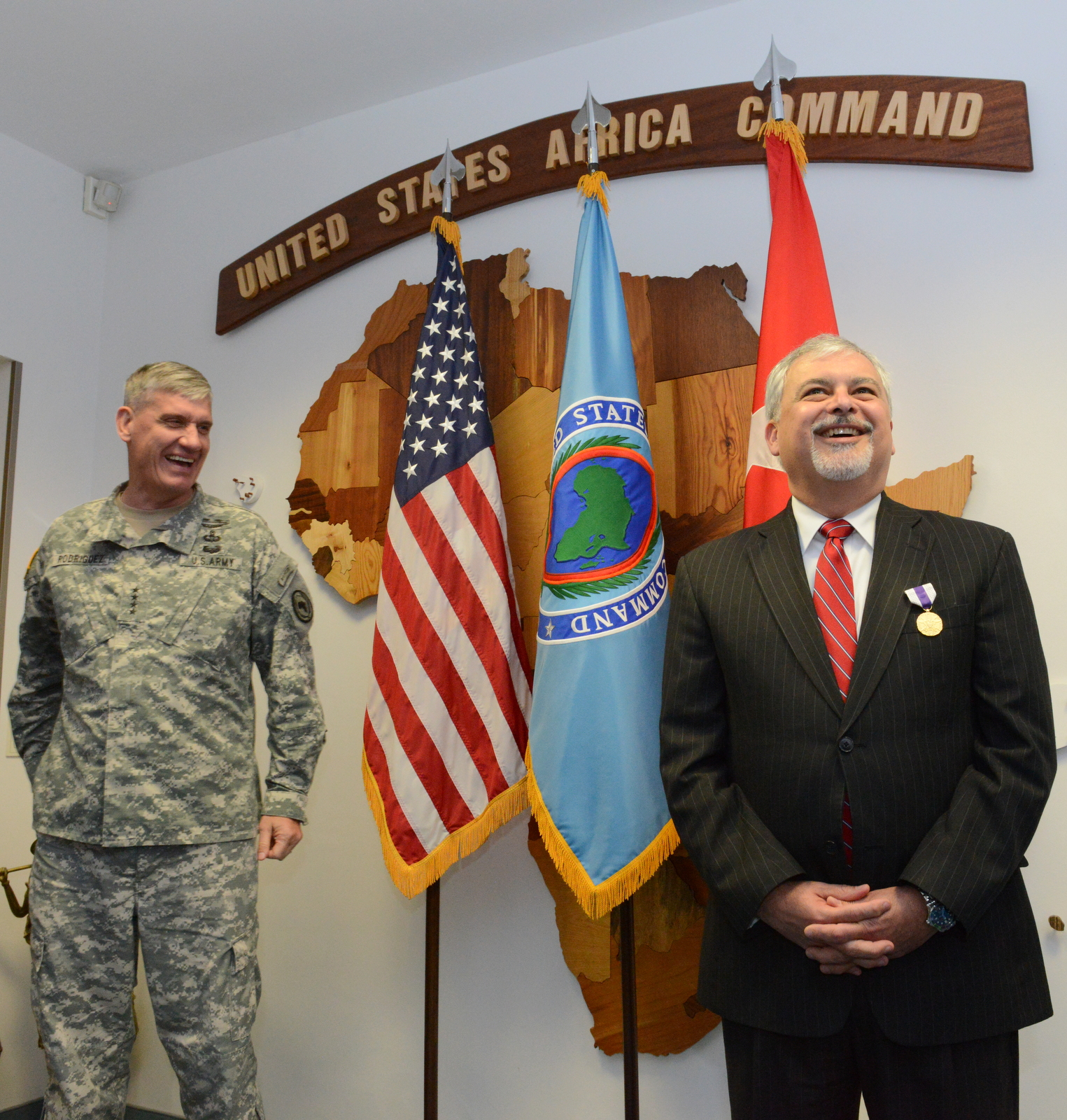 Ambassador Phillip Carter III, right, the command's outgoing deputy to the commander for civil military engagement,and U.S. Army Gen. David Rodriguez, commander of U.S. Africa Command, address members of the AFRICOM staff at Kelley Barracks, U.S. Army Garrison Stuttgart, Germany, Sept. 17, 2015. Rodriguez awarded Carter with the Joint Distinguished Civilian Service Award, the highest military award a civilian can earn from a joint command or staff.