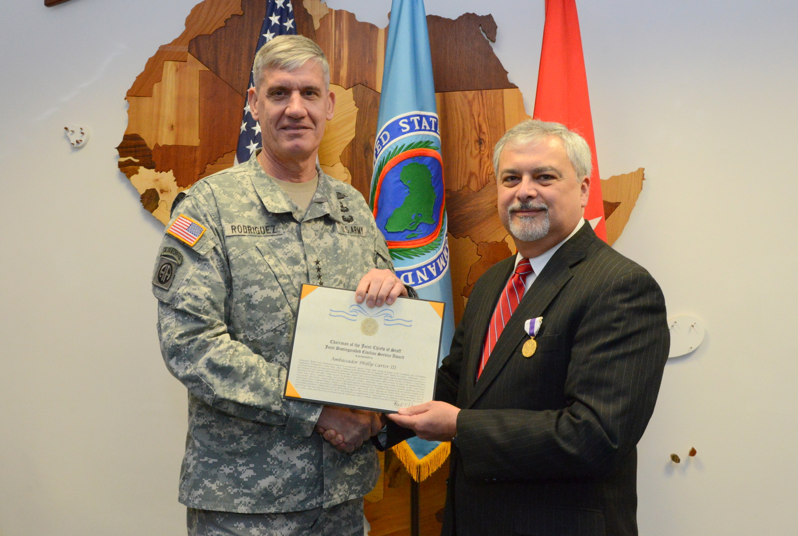 U.S. Army Gen. David Rodriguez, left, commander of U.S. Africa Command presents the Joint Distinguished Civilian Service Award to Ambassador Phillip Carter III, the outgoing deputy to the commander for civil military engagement with U.S. Africa Command, during a ceremony at Kelley Barracks, U.S. Army Garrison Stuttgart, Germany, Sept. 17, 2015. Carter served as the commander's senior diplomat since November 2013.