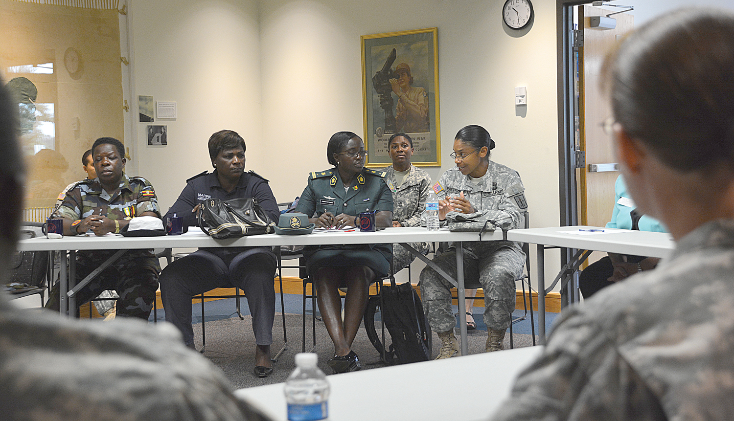 Col. Tamatha A. Patterson, commander, 23rd Quartermaster Brigade, right, gives a command brief to a delegation of military women from nine African countries during a visit to the Army Women's Museum Sept. 21. The group was part of the Women's Communications Forum, which is a military-to-military engagement through U.S. Africa Command that sent 11 foreign communications officers and senior NCOs to the United States. The forums support's the command's mission to build the military capacity of partner nations in Africa while also supporting the president's National Action Plan on Women's Peace and Security. (Photo by Amy Perry, Fort Lee Public Affairs)
