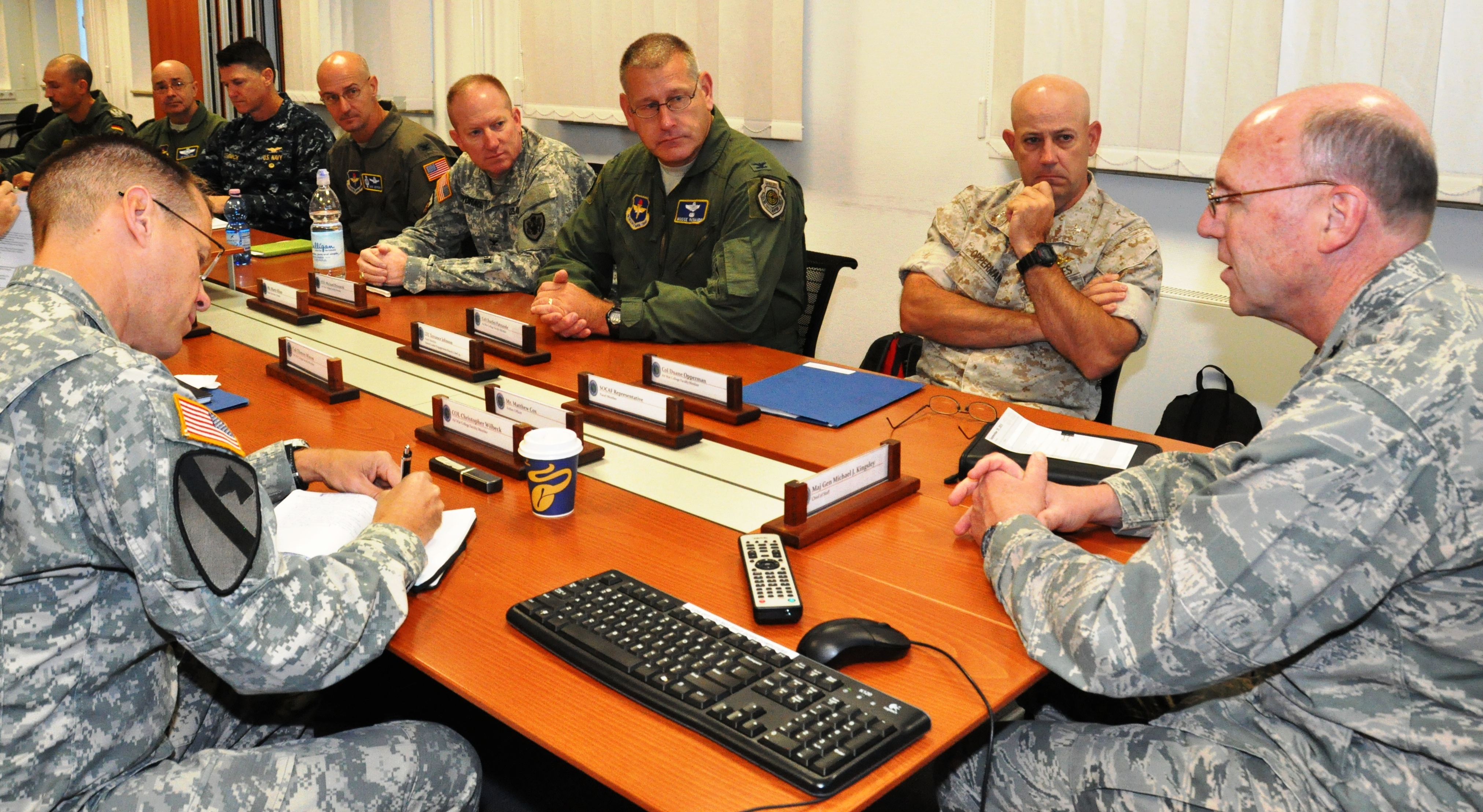 AFRICOM hosts faculty from the U.S. Air War College: U.S. AFRICOM Chief of Staff, U.S. Air Force Maj. Gen. Michael Kingsley (far right), welcomes faculty from the U.S. Air War College, Sept. 29, 2015.  The 16 faculty members were briefed by select AFRICOM staff about the commands mission and programs. (USAFRICOM photo by Brenda Law/Released)