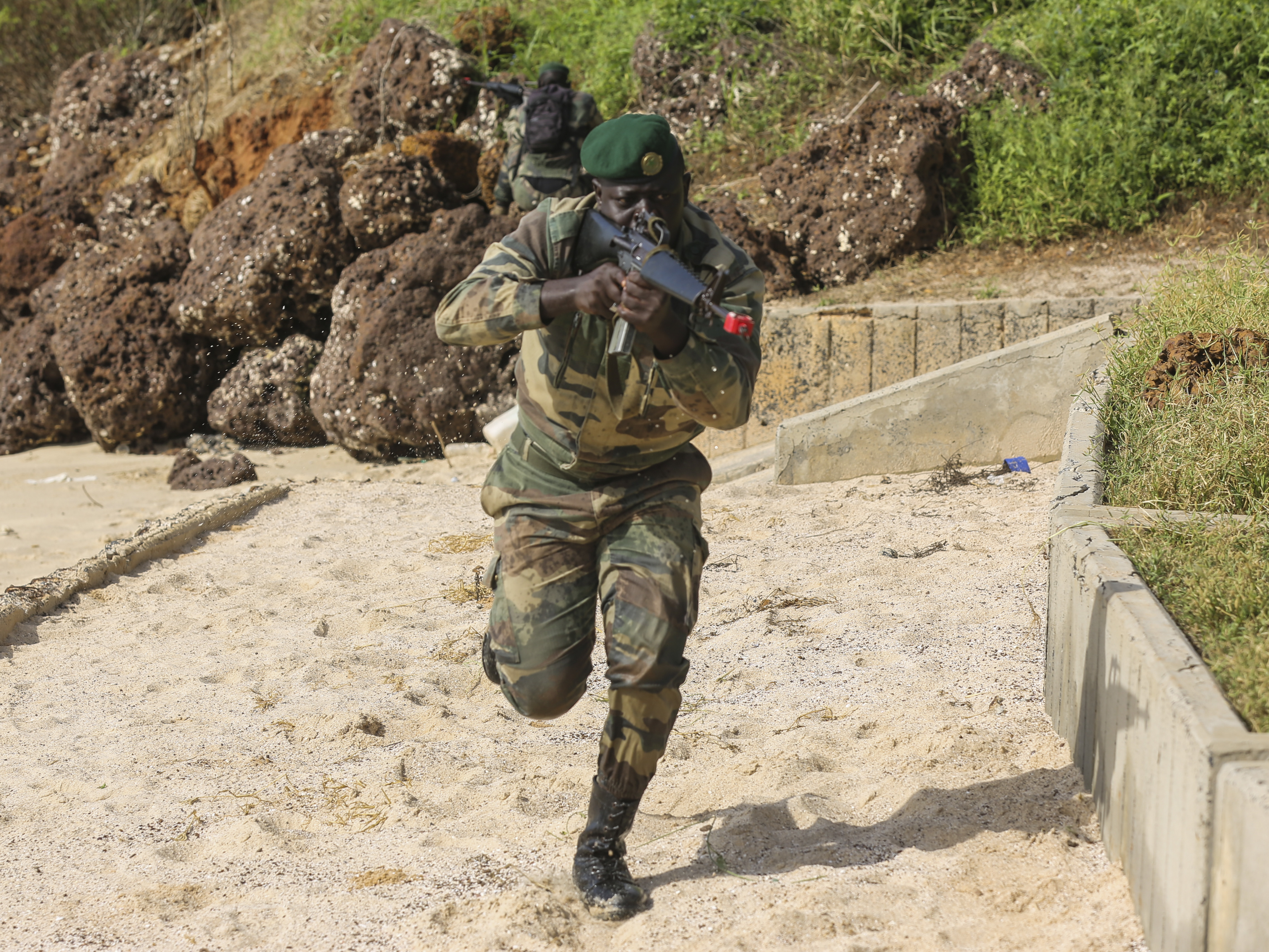 A Compagnie Fusilier de Marin Commando raids the beach during the final exercise with U.S. service members in Dakar, Senegal, Sept. 17, 2015. The Marines and Coast Guardsmen with Special-Purpose Marine Air-Ground Task Force Crisis Response-Africa spent four weeks training the COFUMACO on basic infantry tactics and small-boat operations as a part of a Maritime Security Force Assistance mission to increase interoperability with Senegal's and strengthen the bond between the partner nations.  (U.S. Marine Corps photo by Cpl. Olivia McDonald/Released)