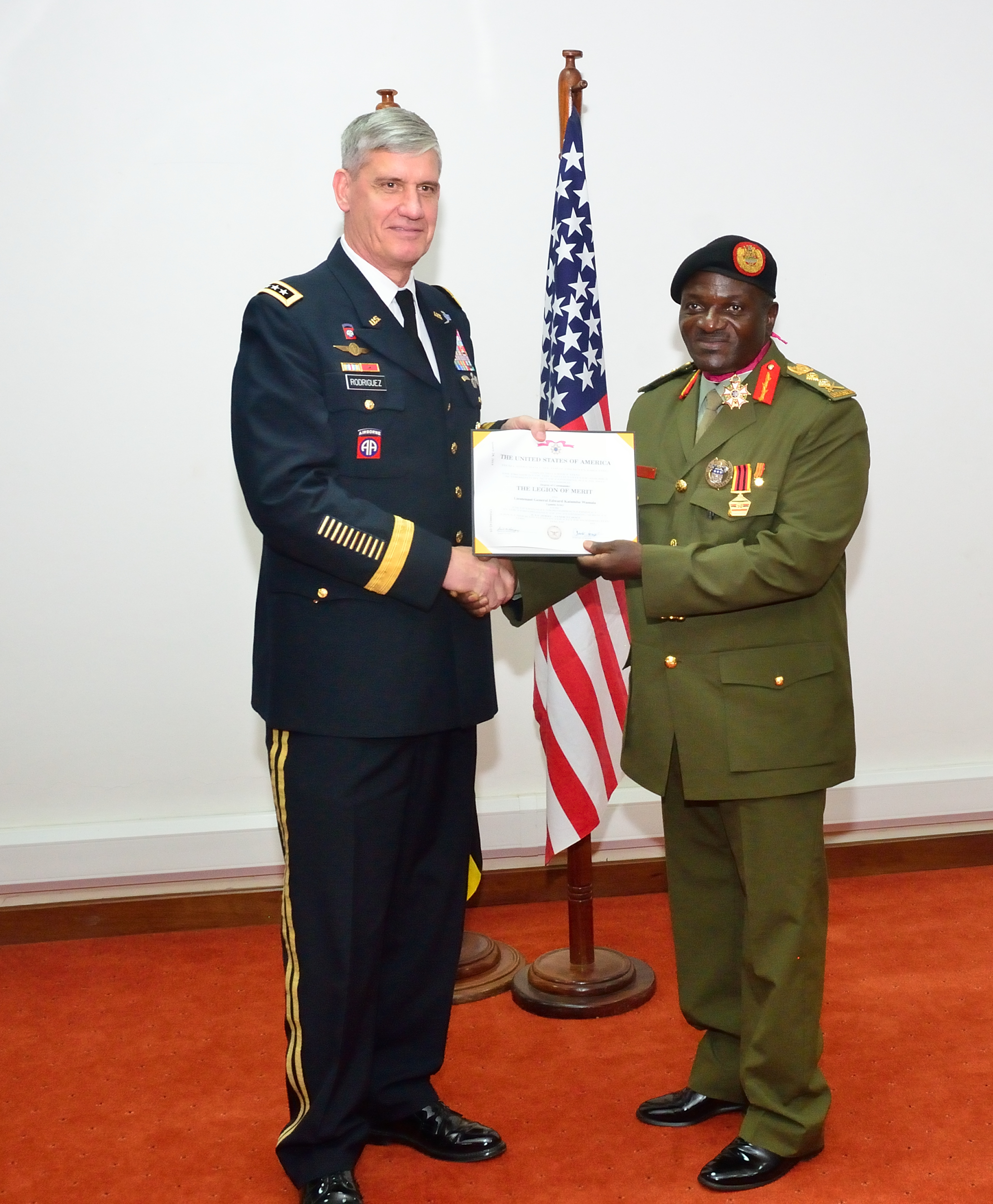 U.S. Army Gen. David M. Rodriguez, the commander of U.S. Africa Command met Ugandan Chief of Defense Forces Katumba Wamala and other senior officials of the Uganda People's Defense Forces in Kampala Sept. 30, 2015. Rodriguez also presented the Legion of Merit, the highest U.S. military award for foreign citizens, to six Ugandan People's Defense Force officers. (Photo courtesy U.S. Embassy - Kampala)