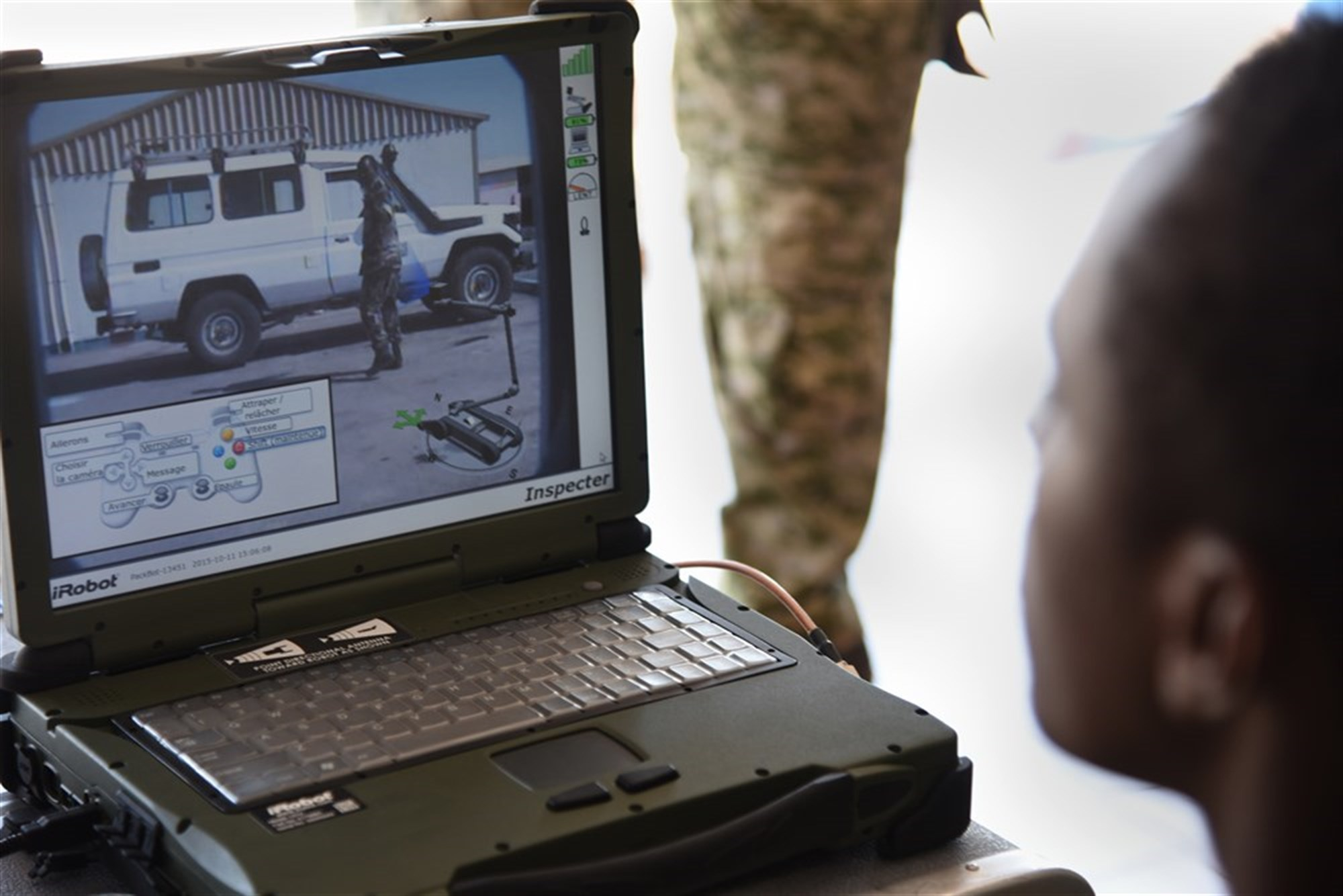 Members of the Djibouti Armed Forces (FAD) monitor a computer transmitting video from the iRobot 510 Packbot Oct. 12, 2015, in Djibouti. The robot can perform bomb disposal, surveillance and reconnaissance operations.