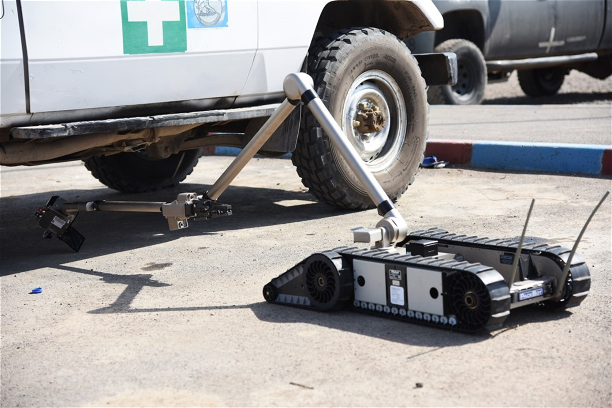 An iRobot 510 Packbot searches for explosive devices under a vehicle during a training course in Djibouti, Oct. 12, 2015. Djibouti Armed Forces (FAD) service members and explosive ordnance disposal technicians assigned at Camp Lemonier learned how to operate the robot