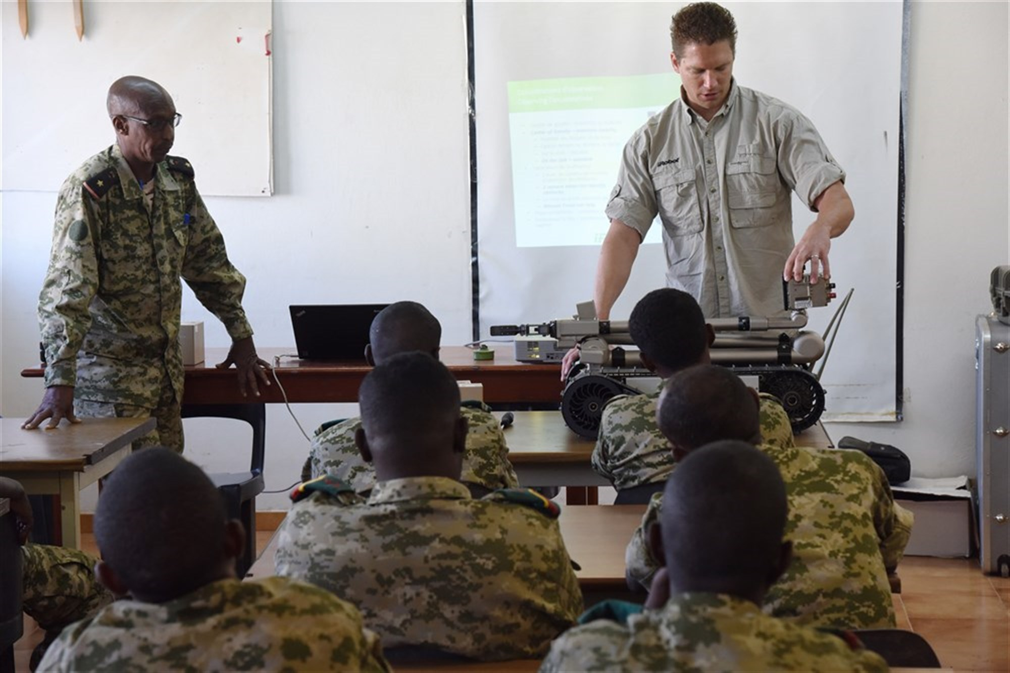 Joseph Brunette, iRobot instructor, leads a class on the 510 Packbot to Djibouti Armed Forces (FAD) service members Oct. 12, 2015 in Djibouti. The robot can perform bomb disposal, surveillance and reconnaissance operations.