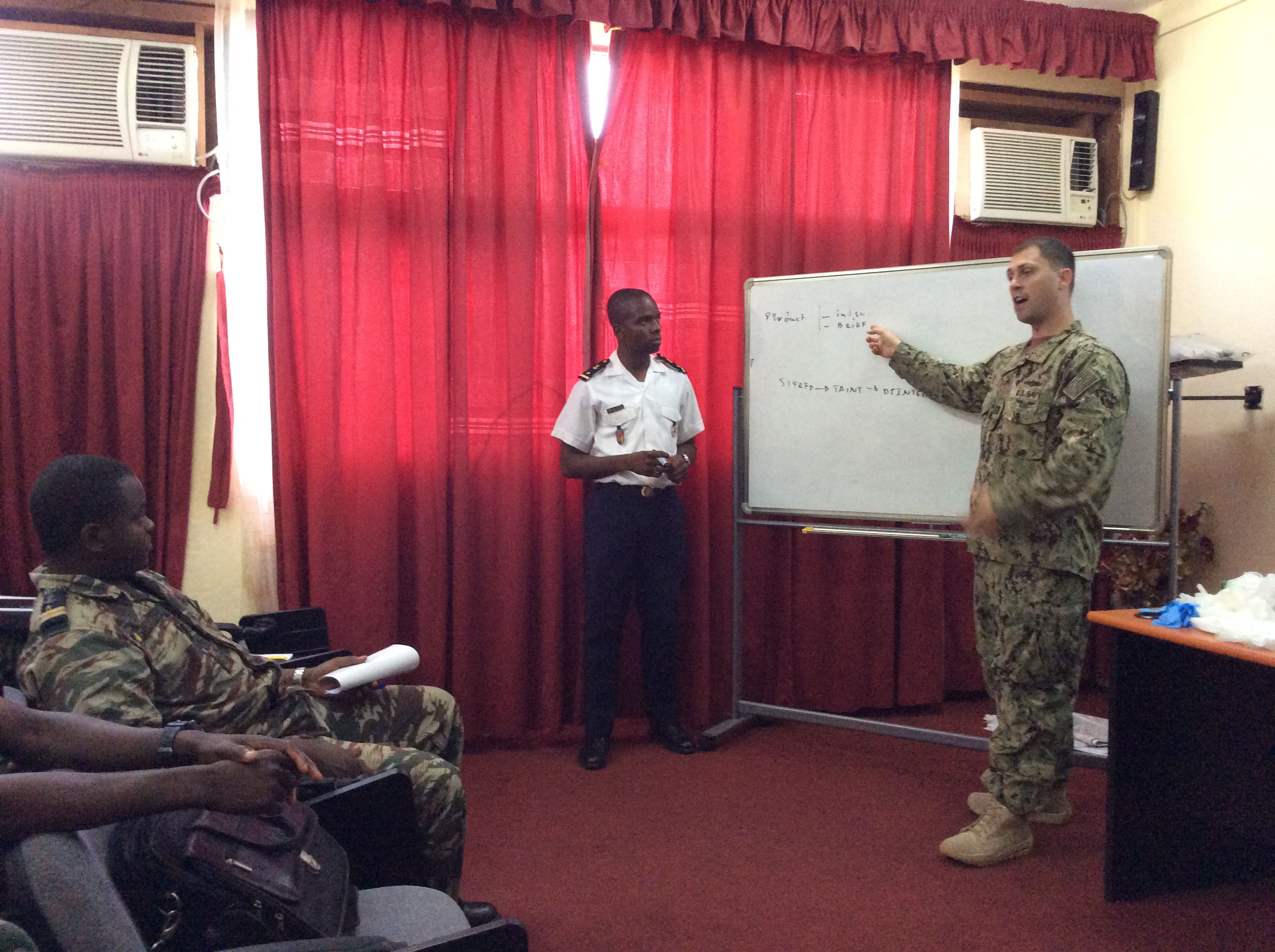 150923-M-ZZ999-300 DOUALA, Cameroon  (Sept. 23, 2015) Lt. Chris Jordan, intelligence officer for Commander, Task Force 68 (CTF 68) discusses the basic intel cycle to Cameroon military forces Sept. 23, 2015. The training was a coordinated effort between CTF 68 and Marines from U.S. Marine Corps Forces Europe and Africa and Special Purpose Marine Air Ground Task Force-Crisis Response-Africa. (U.S. Marine Corps photo by Maj. Oliver Talbott/Released)